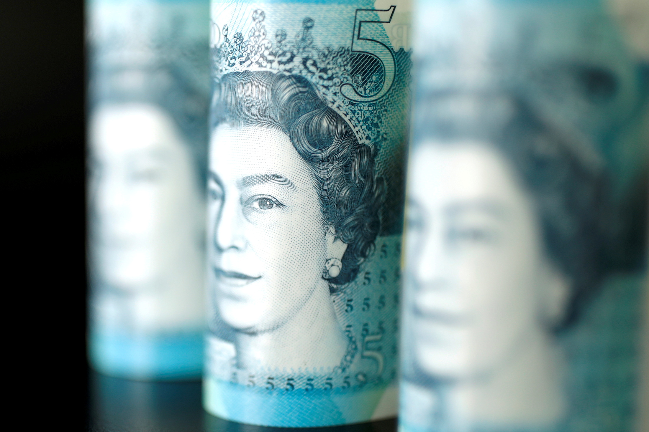British five pound banknotes are seen in this picture illustration taken November 14, 2017. REUTERS/ Benoit Tessier/Illustration/File Photo