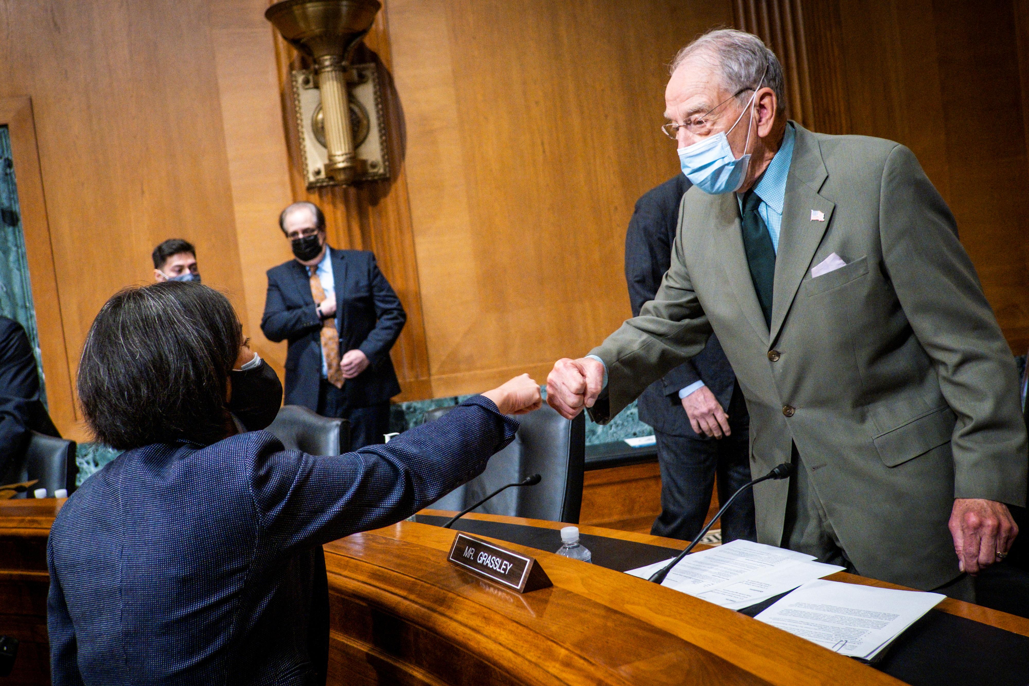 U.S. Trade Representative Katherine Tai fist bumps with Sen. Chuck Grassley (R-IA) before she testifies before the Senate Finance Committee on Capitol Hill in Washington, U.S., May 12, 2021.  Pete Marovich/Pool via REUTERS