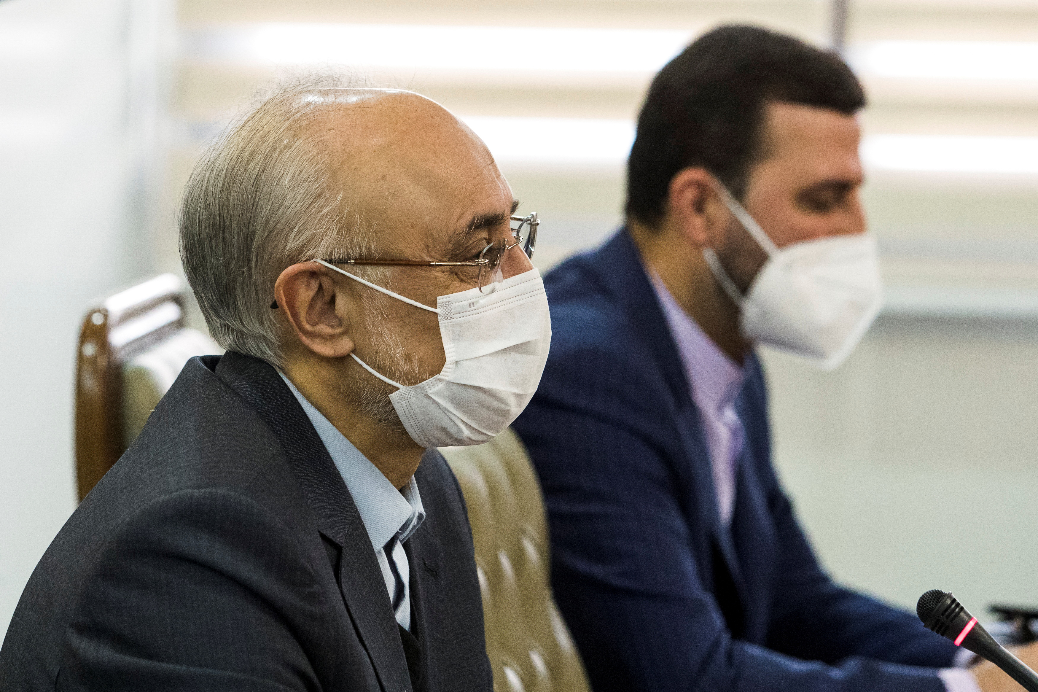 Head of Iran's Atomic Energy Organization Ali-Akbar Salehi wears a mask as he speaks during a meeting with International Atomic Energy Agency (IAEA) Director General Rafael Grossi, in Tehran, Iran February 21, 2021. Hadi Zand/WANA (West Asia News Agency) via REUTERS ATTENTION EDITORS - THIS IMAGE HAS BEEN SUPPLIED BY A THIRD PARTY.