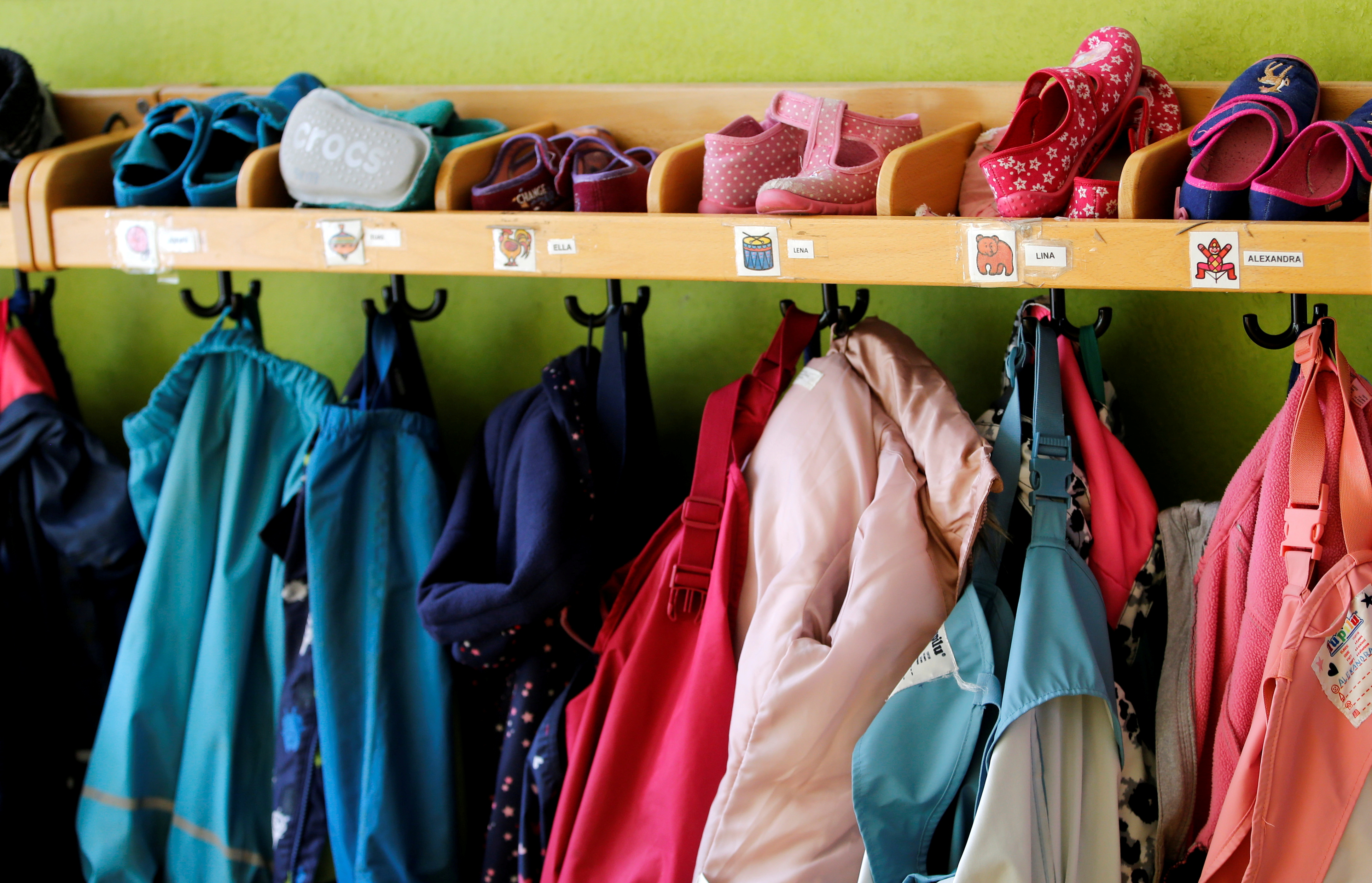 A coat rack with children's clothing is seen at a nursery school as the spread of the coronavirus disease (COVID-19) continues, Velbert, Germany, April 8, 2021. REUTERS/Leon Kuegeler
