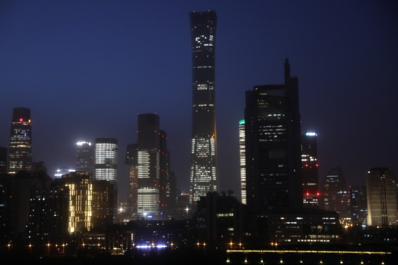 Buildings in the Central Business District (CBD) are seen lit up during the night in Beijing, China April 15, 2021. Picture taken April 15, 2021. REUTERS/Tingshu Wang