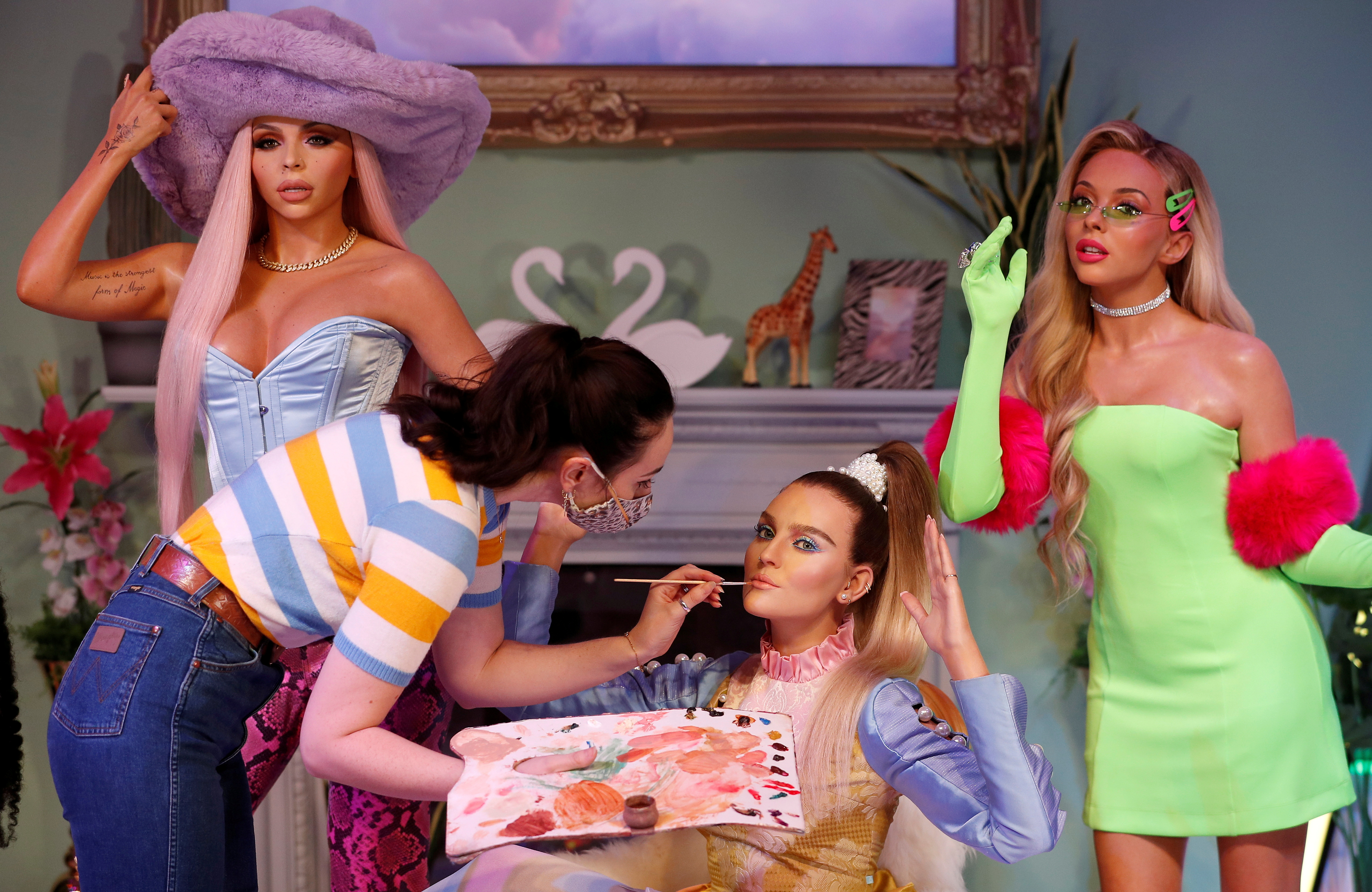 A waxworks artist retouches one of the wax figures at the unveiling of Little Mix waxwork figures at Madame Tussauds, in London, Britain, July 28, 2021.  REUTERS/Peter Nicholls     TPX IMAGES OF THE DAY