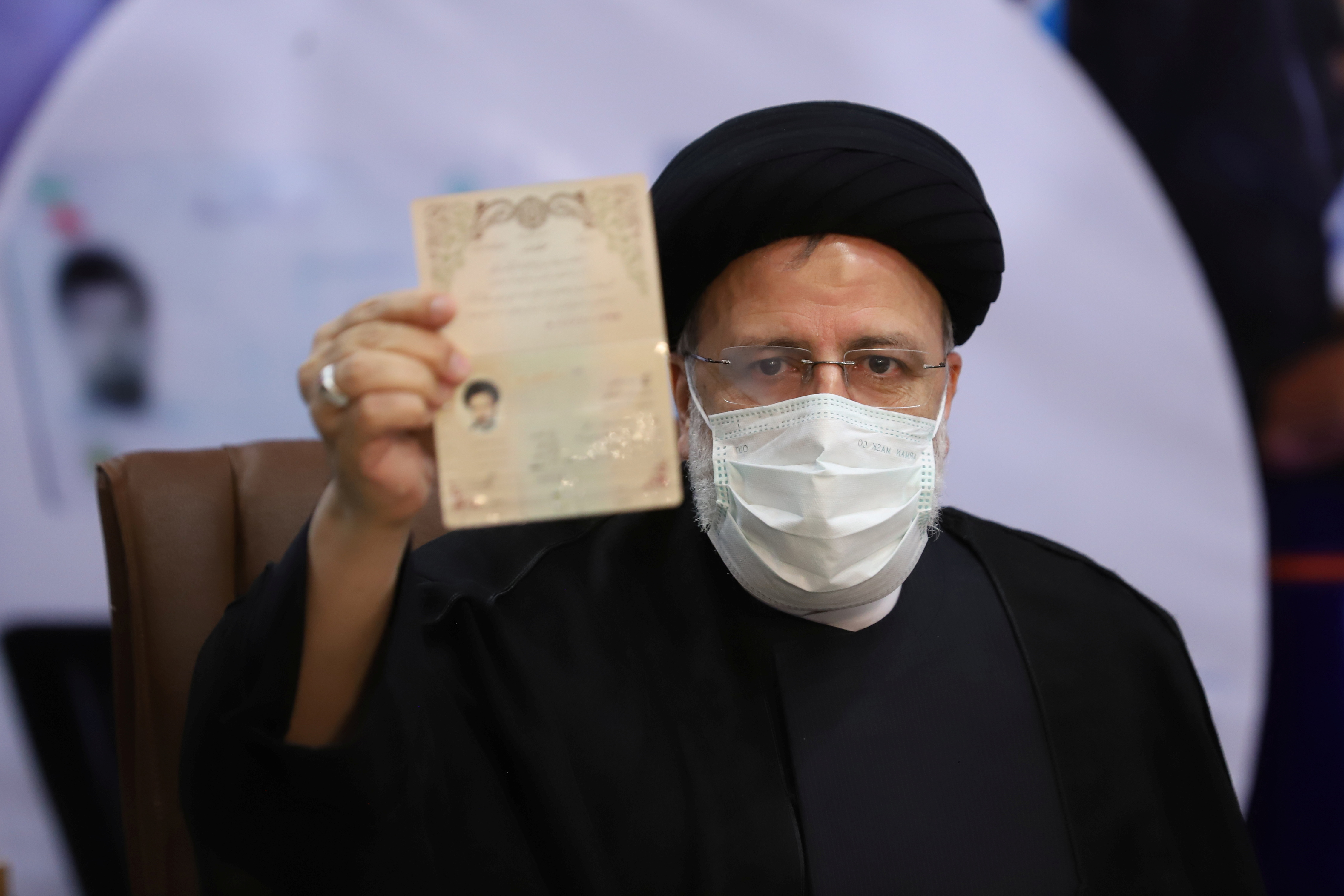 Ebrahim Raisi, Chief Justice of Iran, shows his identification document as he registers as a candidate for the presidential election at the Interior Ministry, in Tehran, Iran May 15, 2021. Majid Asgaripour/ WANA (West Asia News Agency) via REUTERS