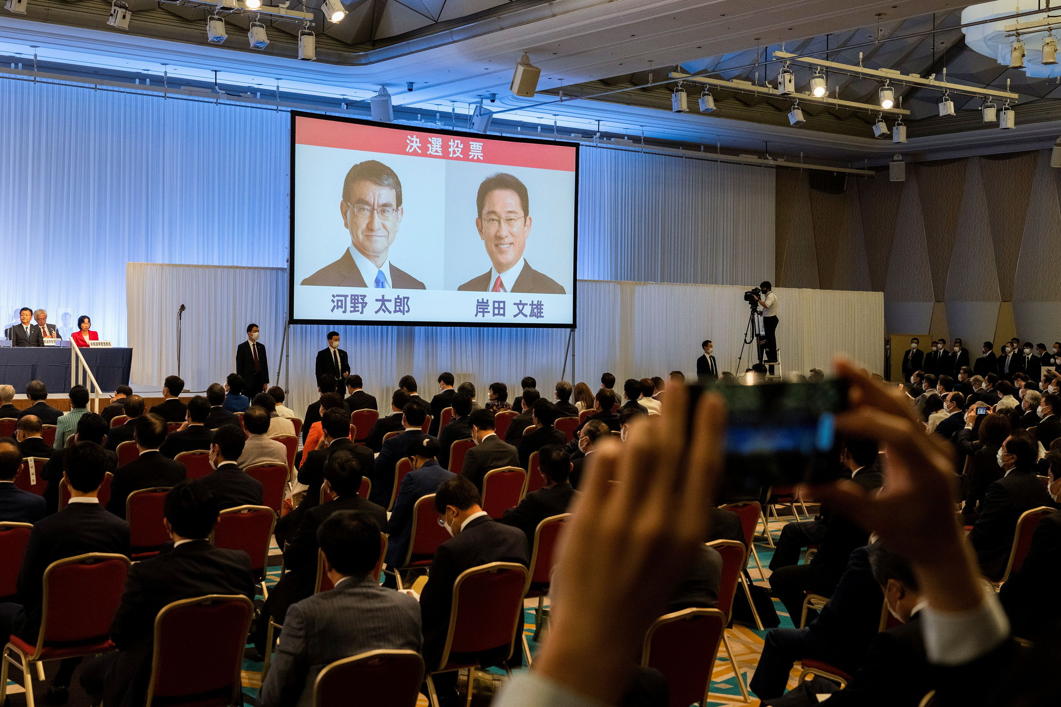 Liberal Democrat Party leadership candidates, Taro Kono and Fumio Kishida are displayed on a screen during the party leadership election in Tokyo, Japan September 29, 2021. Carl Court/Pool via REUTERS