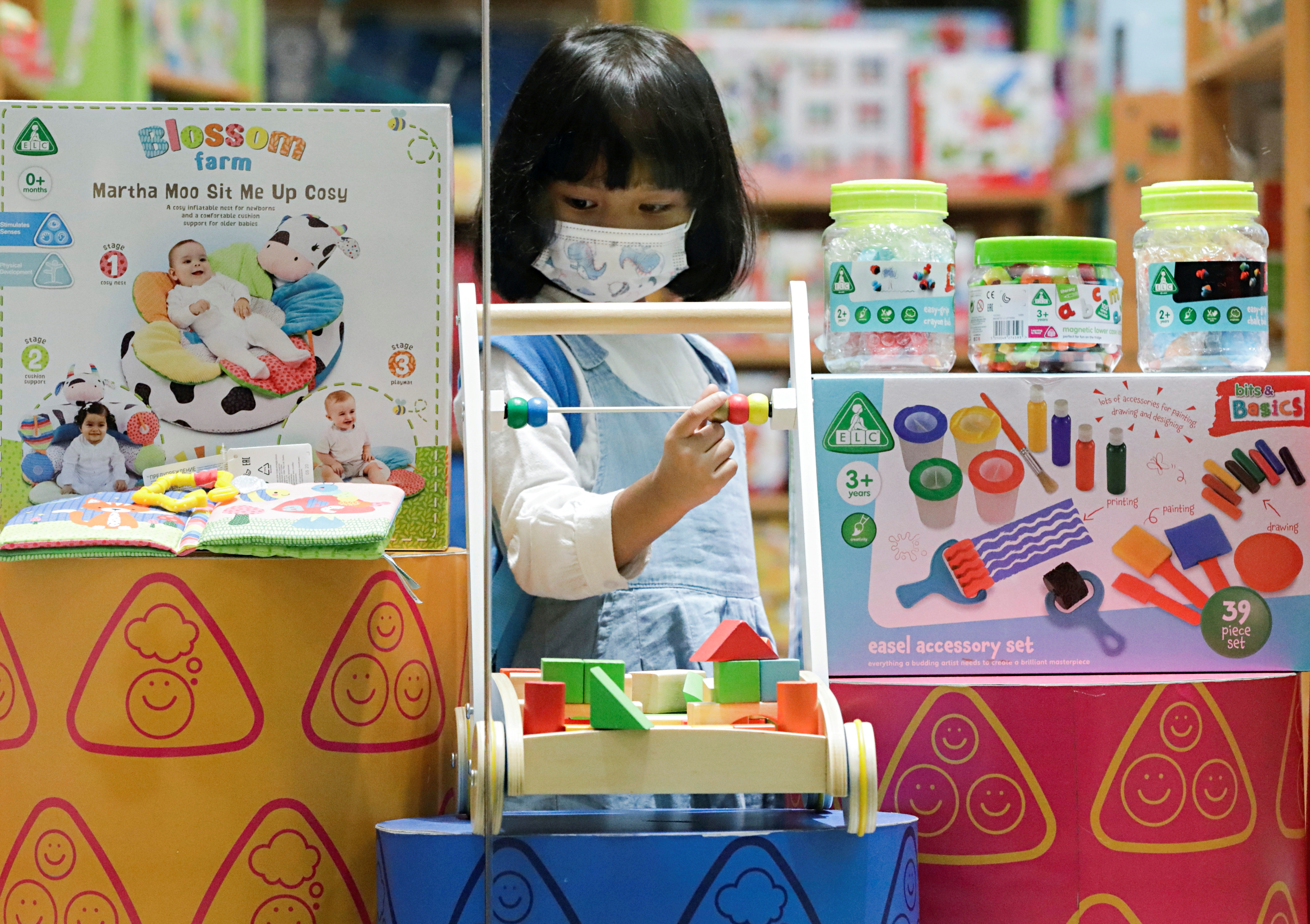 Mezzaluna, 5, plays at a toys outlet after the ease of restrictions with a new policy under which children under the age of 12 are allowed to enter at a Kota Kasablanka shopping mall, amid the coronavirus disease (COVID-19) pandemic in Jakarta, Indonesia, September 22, 2021. REUTERS/Ajeng Dinar Ulfiana