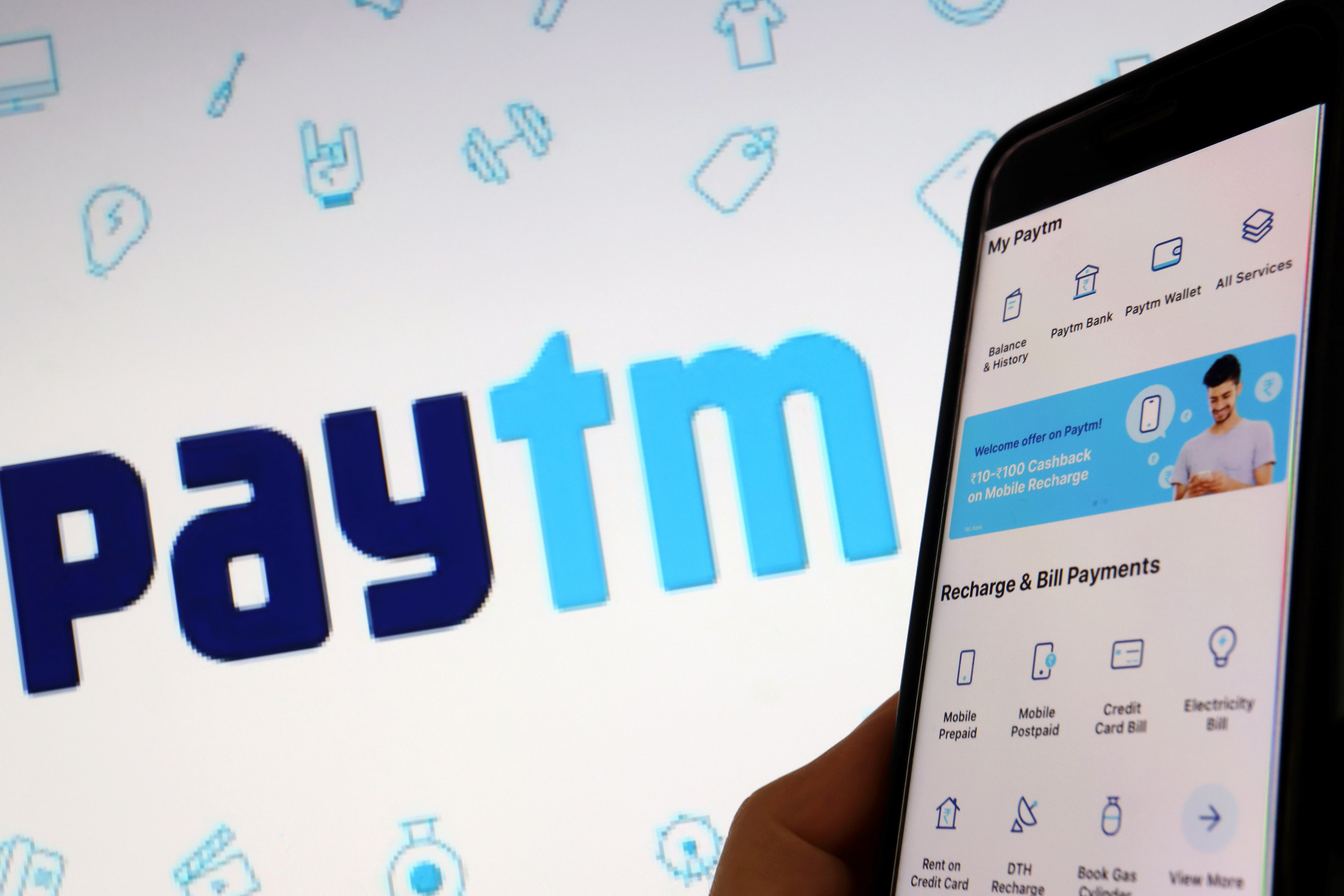 The interface of Indian payments app Paytm is seen in front of its logo displayed in this illustration picture taken July 7, 2021. REUTERS/Florence Lo/Illustration