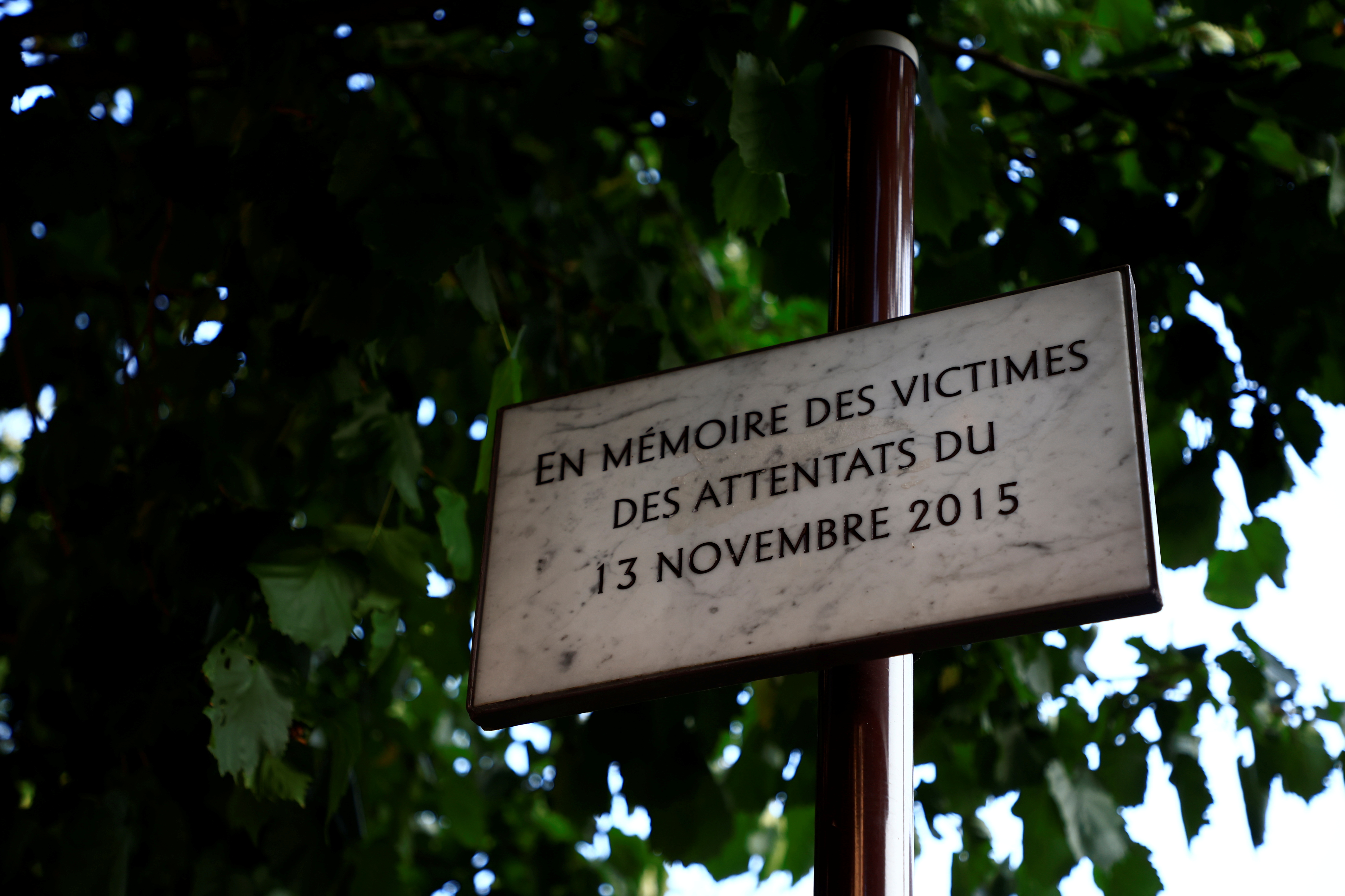 A commemorative plaque for the victims of Paris' November 2015 attacks is seen near the bar and restaurant previously named Comptoir Voltaire in Paris, France, September 1, 2021. Twenty defendants will stand the trial of Paris' November 2015 attacks from September 8, 2021 to May 25, 2022 at Paris courthouse on the Ile de la Cite, with nearly 1,800 civil parties, more than 300 lawyers, hundreds of journalists and large-scale security challenges. Picture taken September 1, 2021. REUTERS/Sarah Meyssonnier