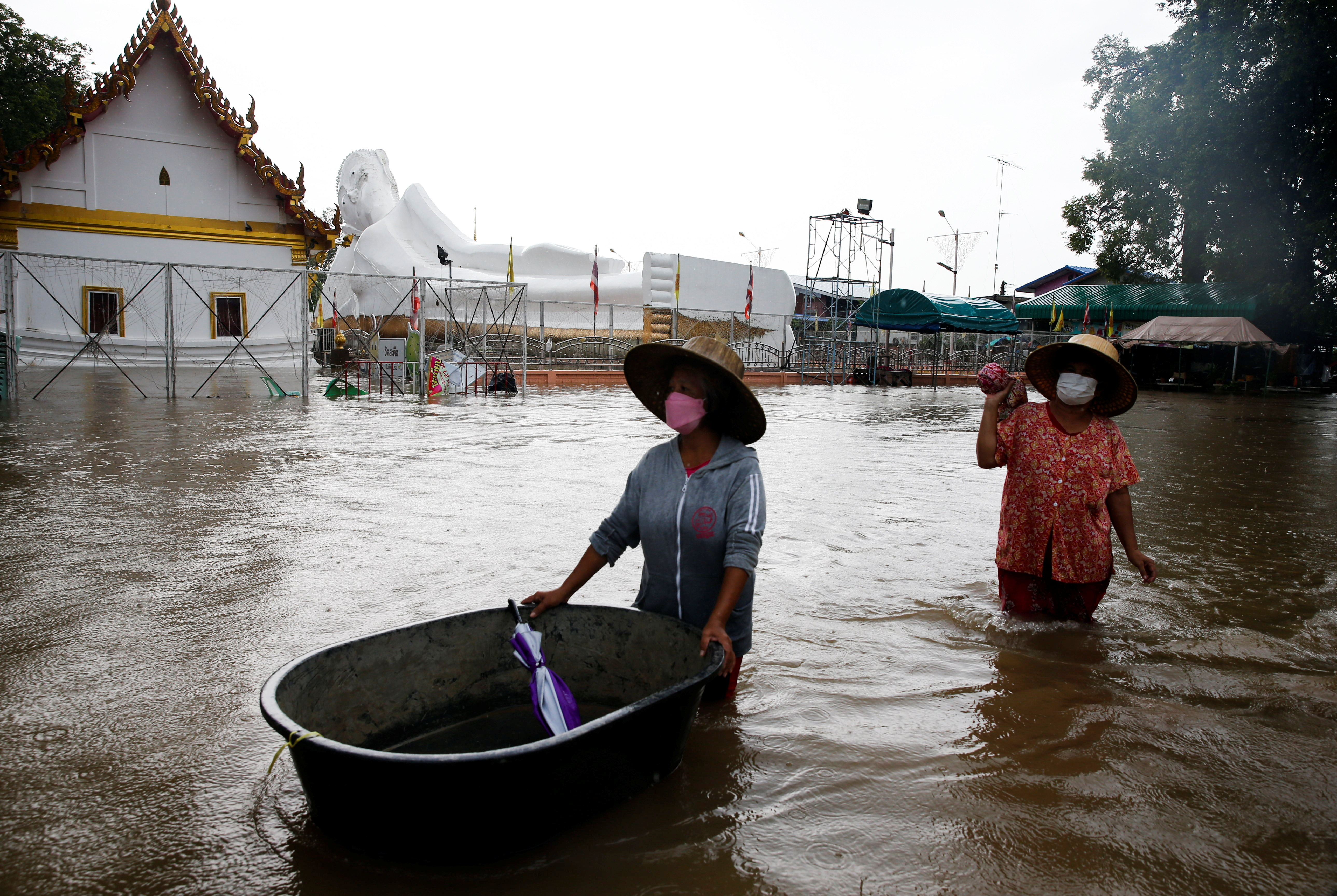 A lying Buddha statue is seen during the flood at a Temple in Ayutthaya, Thailand, October 6, 2021. REUTERS/Soe Zeya Tun
