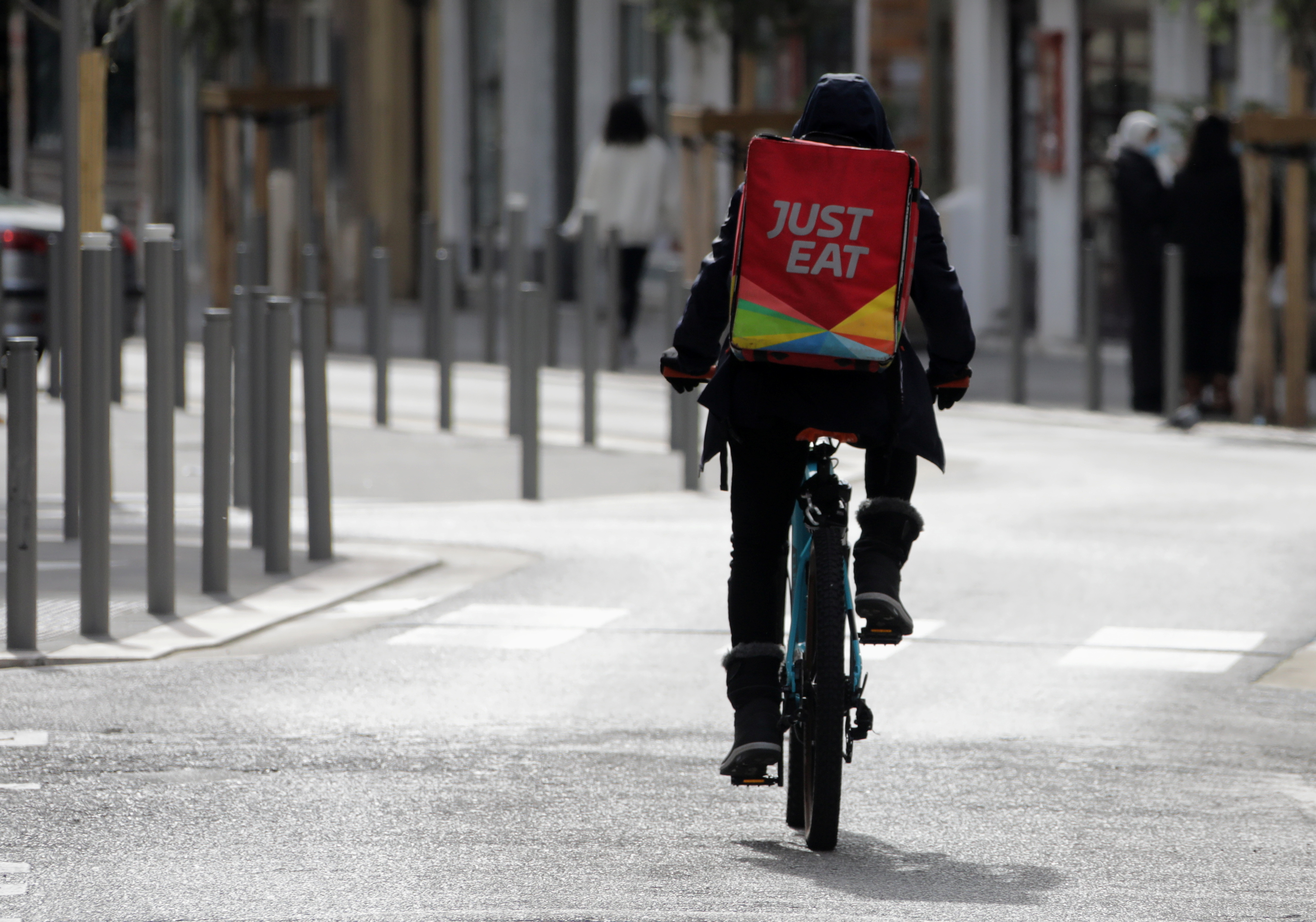 A Just Eat delivery rider is seen in Nice, France, February 16, 2021. REUTERS/Eric Gaillard