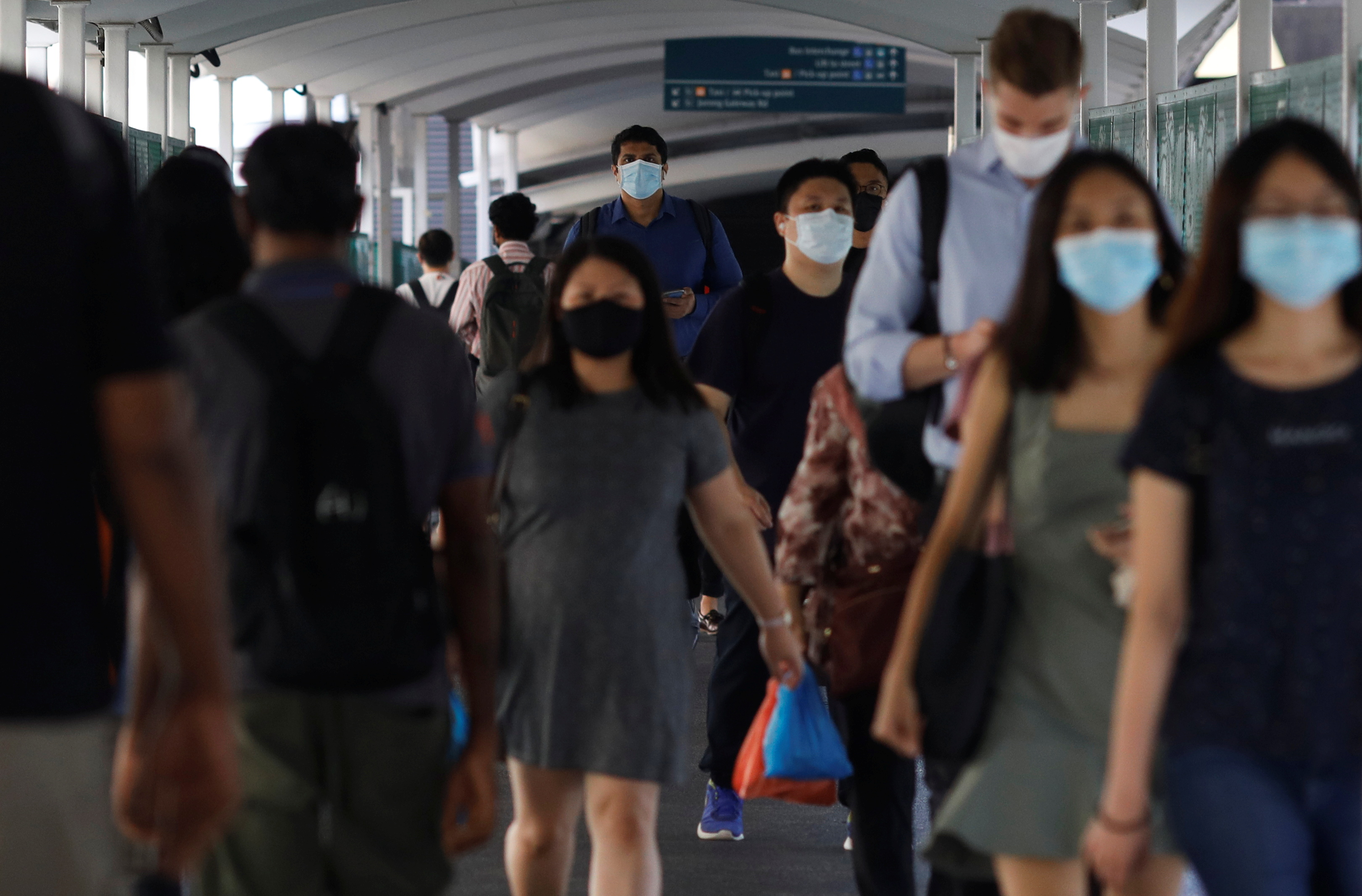 Commuters leave a train station during the coronavirus disease (COVID-19) outbreak, in Singapore, September 23, 2021. REUTERS/Edgar Su