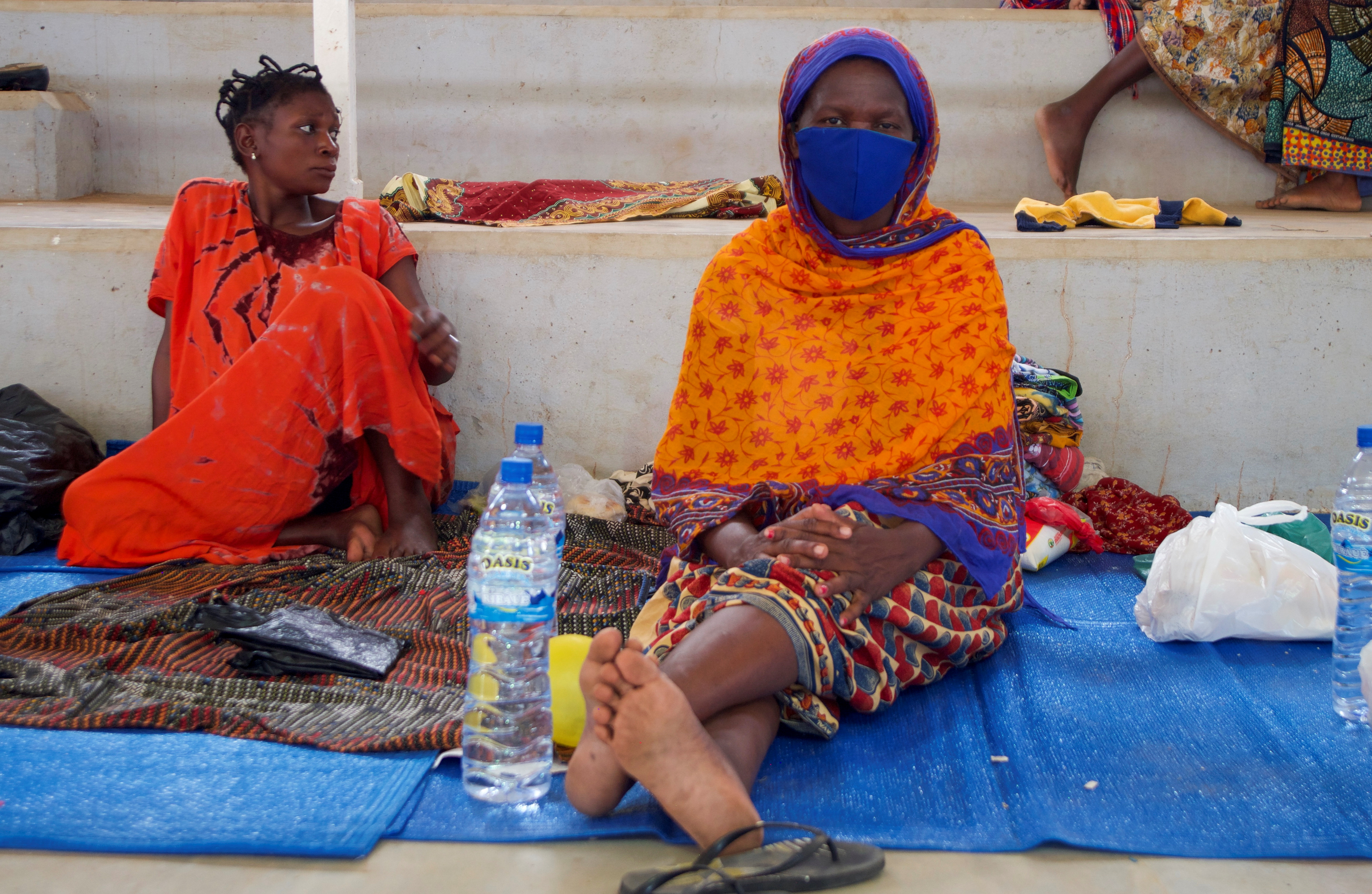 Displaced women sit on mats after fleeing an attack claimed by Islamic State-linked insurgents on the town of Palma, at a displacement centre in Pemba, Mozambique, April 2, 2021. REUTERS/Emidio Jozine