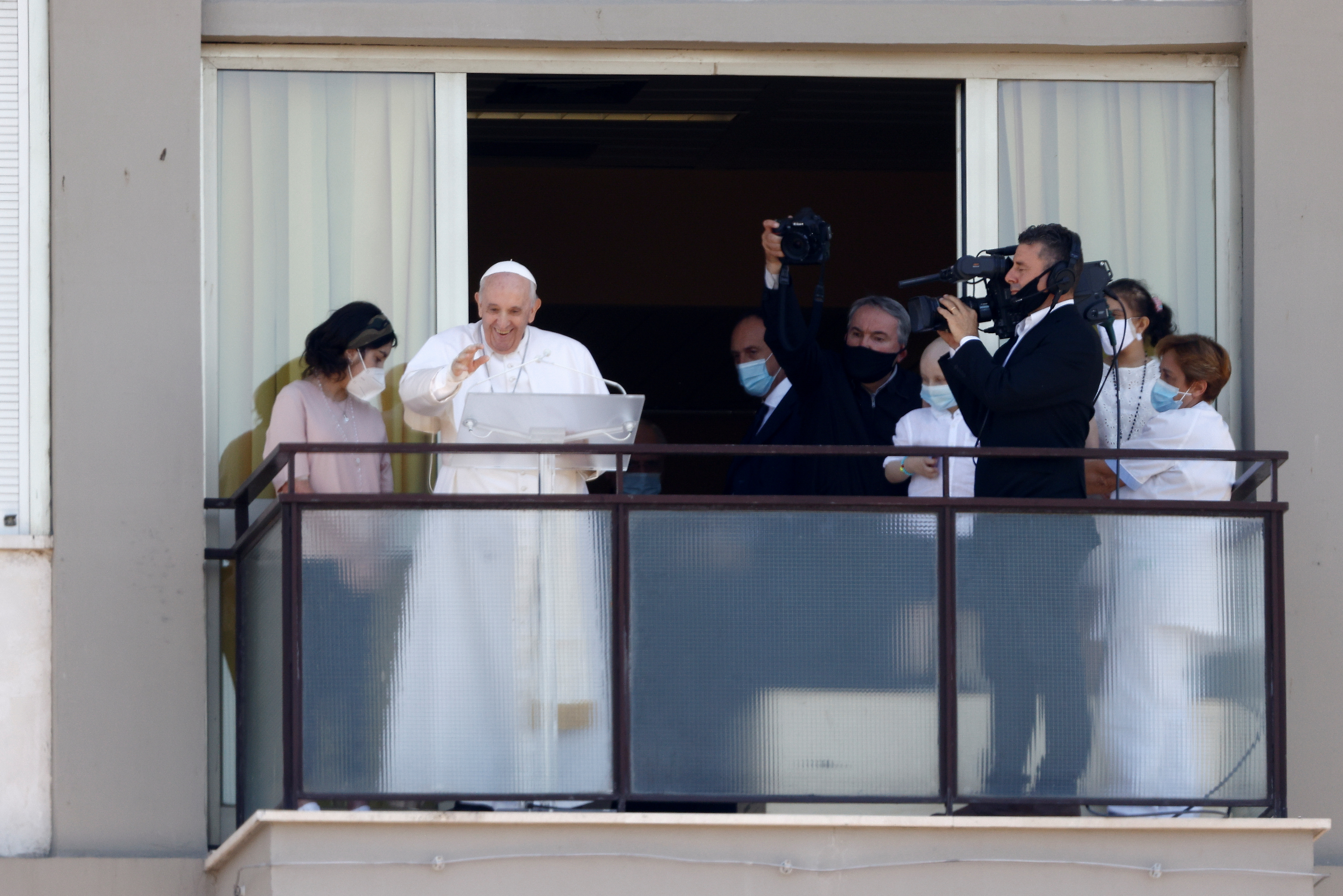 Pope Francis leads the Angelus prayer from a balcony of the Gemelli hospital, as he recovers following scheduled surgery on his colon, in Rome, Italy, July 11, 2021. REUTERS/Guglielmo Mangiapane