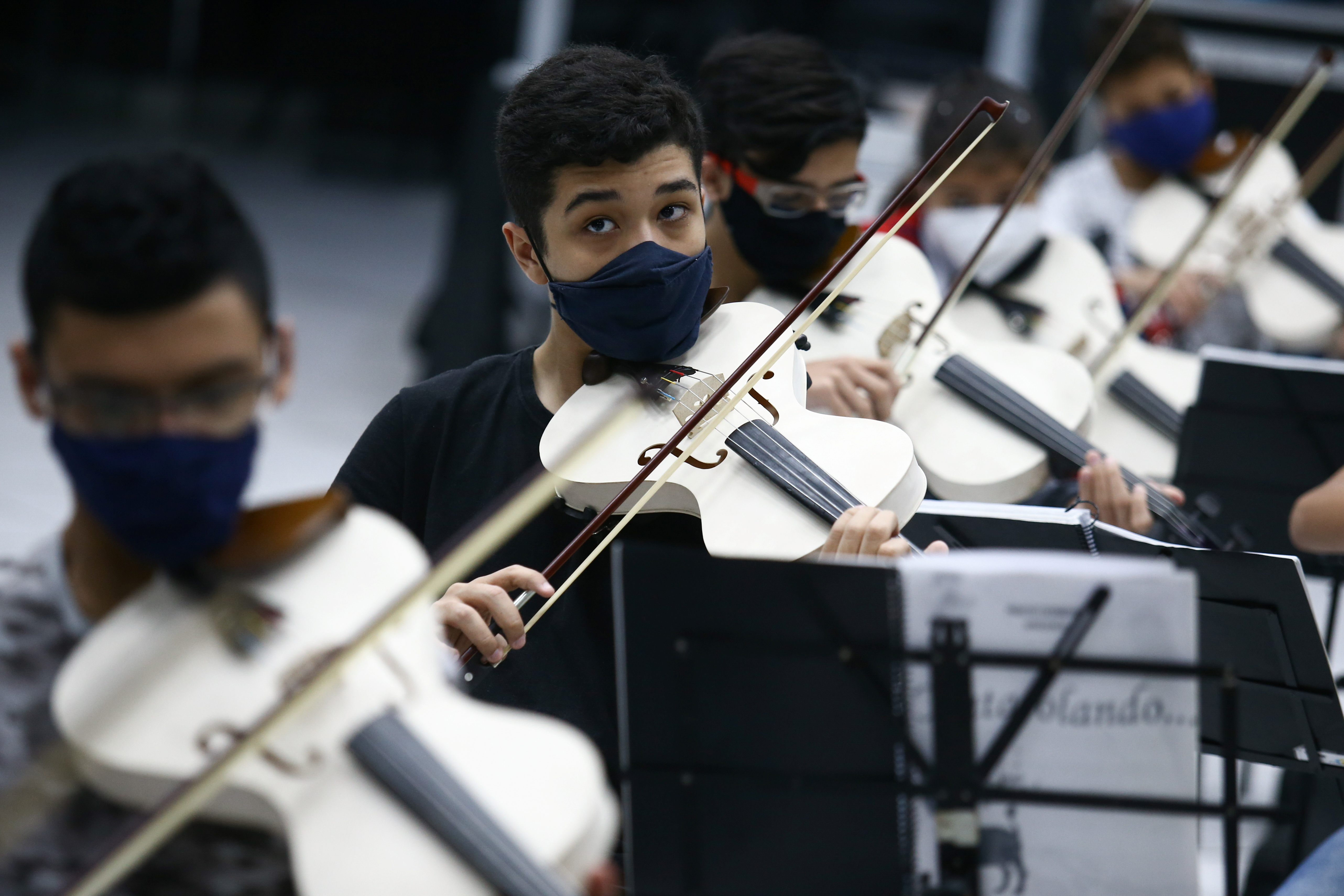 Students play violins made from PVC piping at Locomotiva Project, a free music school for at-risk children in Santo Andre, Brazil September 8, 2021.REUTERS/Carla Carniel