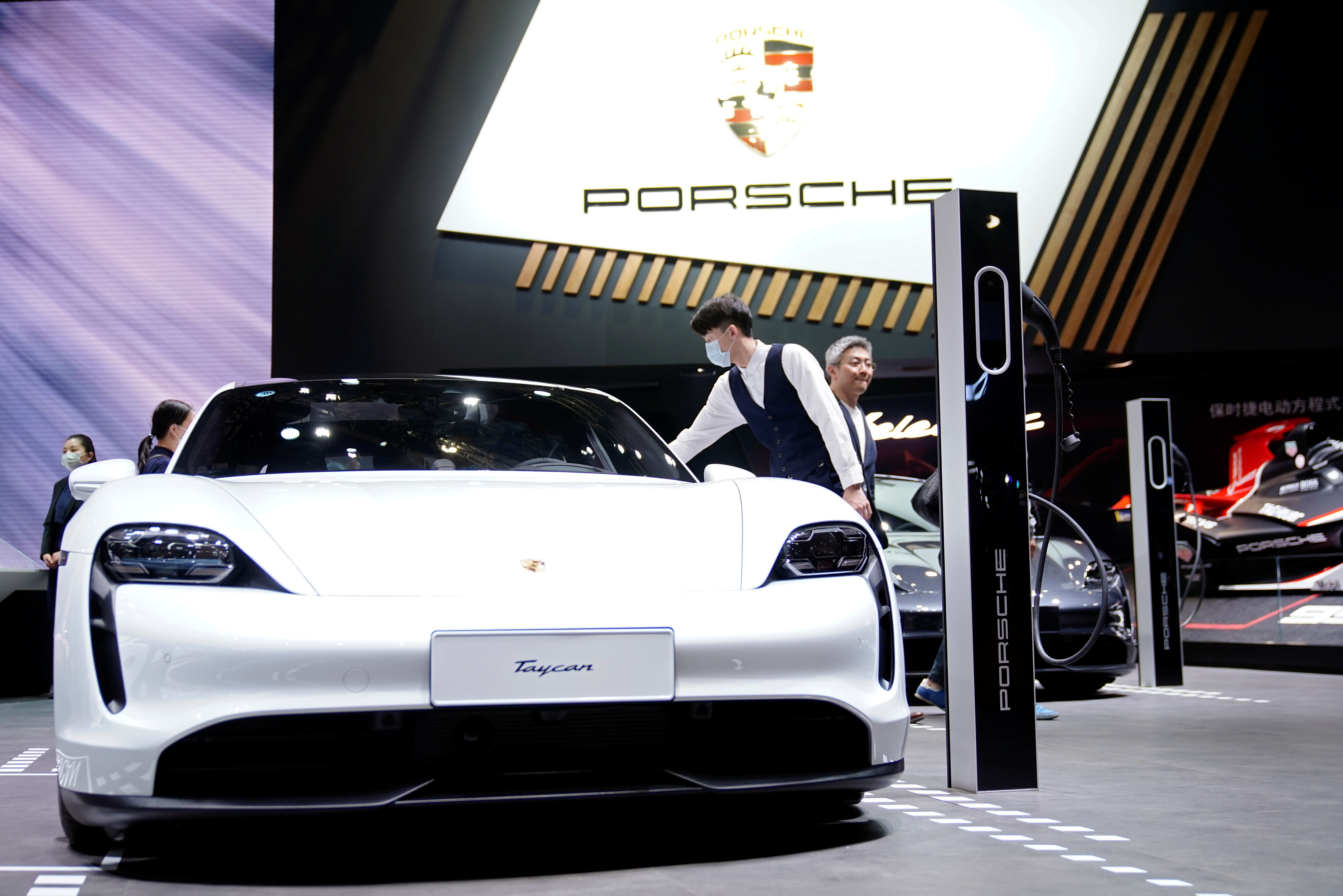 A Porsche Taycan electric vehicle (EV) is seen displayed during a media day for the Auto Shanghai show in Shanghai, China April 20, 2021. REUTERS/Aly Song