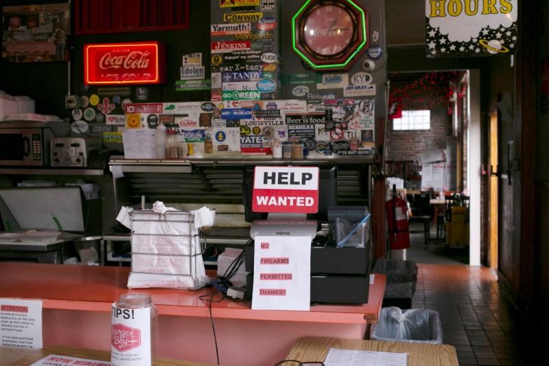 A hiring sign is seen at the register of Burger Boy restaurant, as many restaurant businesses face staffing shortages in Louisville, Kentucky, U.S., June 7, 2021.  REUTERS/Amira Karaoud