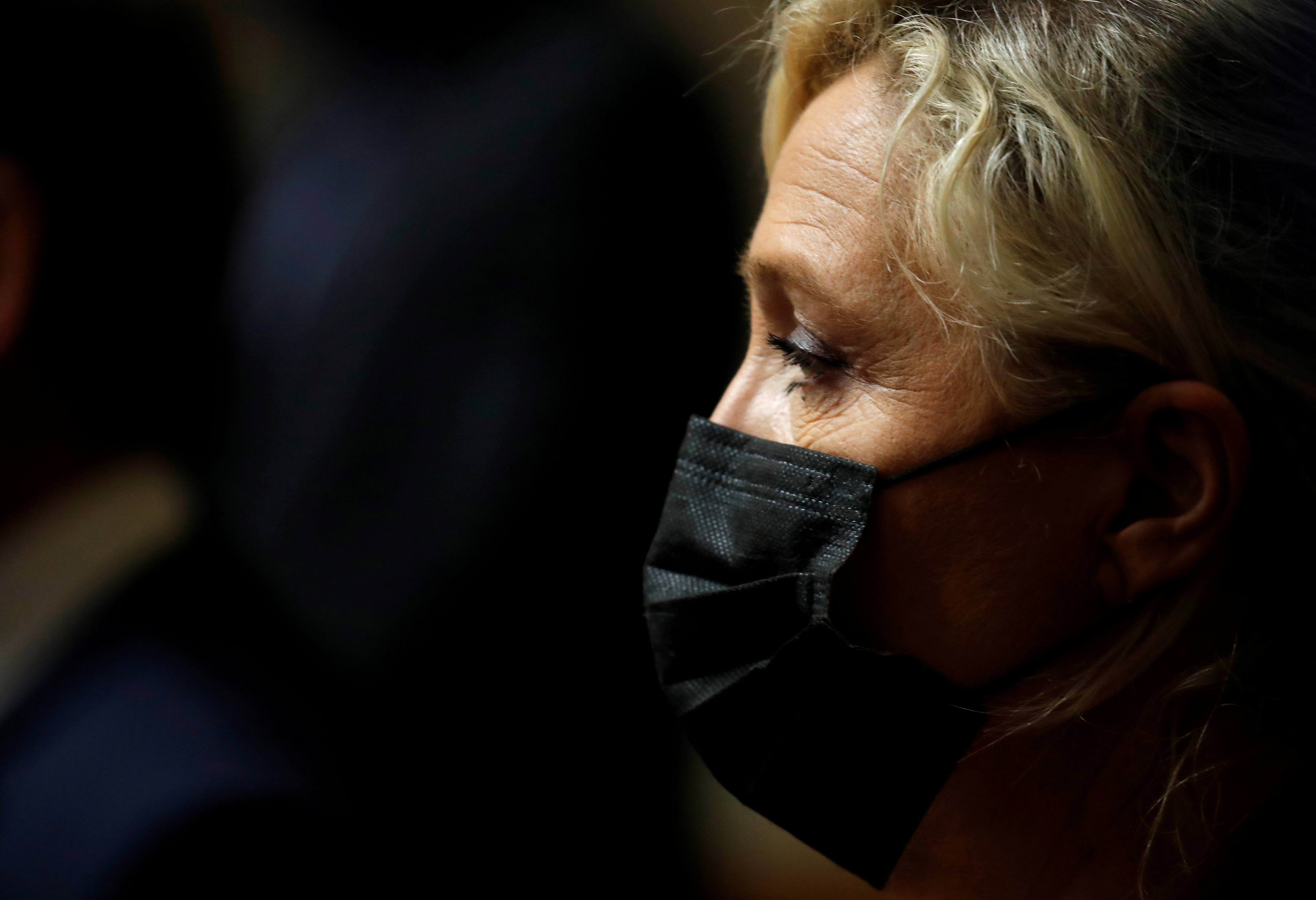 Marine Le Pen, member of parliament and leader of French far-right National Rally (Rassemblement National) party, attends a tribute to Samuel Paty, the French teacher who was beheaded on the streets of the Paris suburb of Conflans-Sainte-Honorine at the National Assembly in Paris, France, October 20, 2020. REUTERS/Gonzalo Fuentes/File Photo
