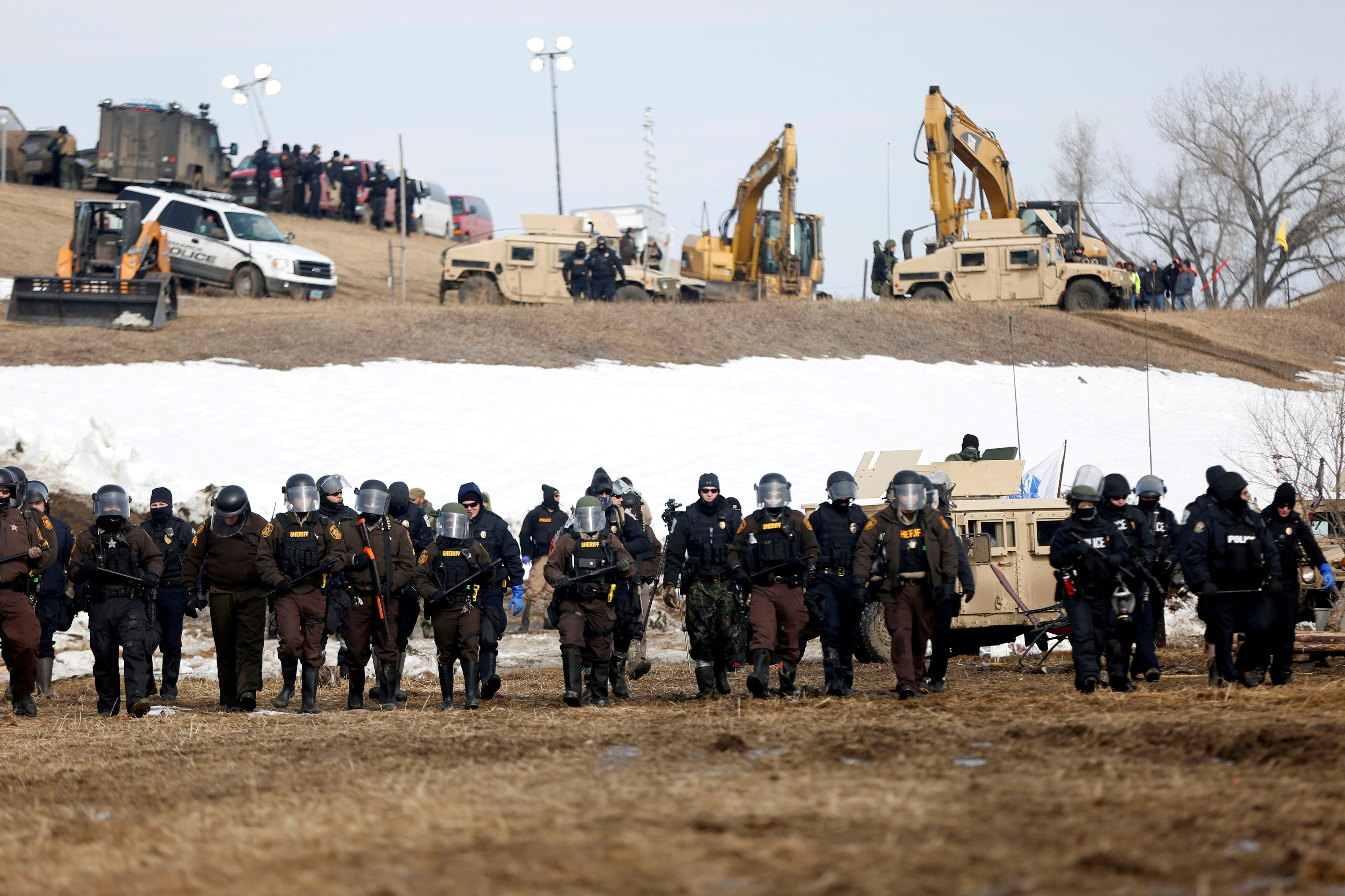 File photo: Law enforcement officers advance into the main opposition camp against the Dakota Access oil pipeline near Cannon Ball, North Dakota, U.S., February 23, 2017. REUTERS/Terray Sylvester