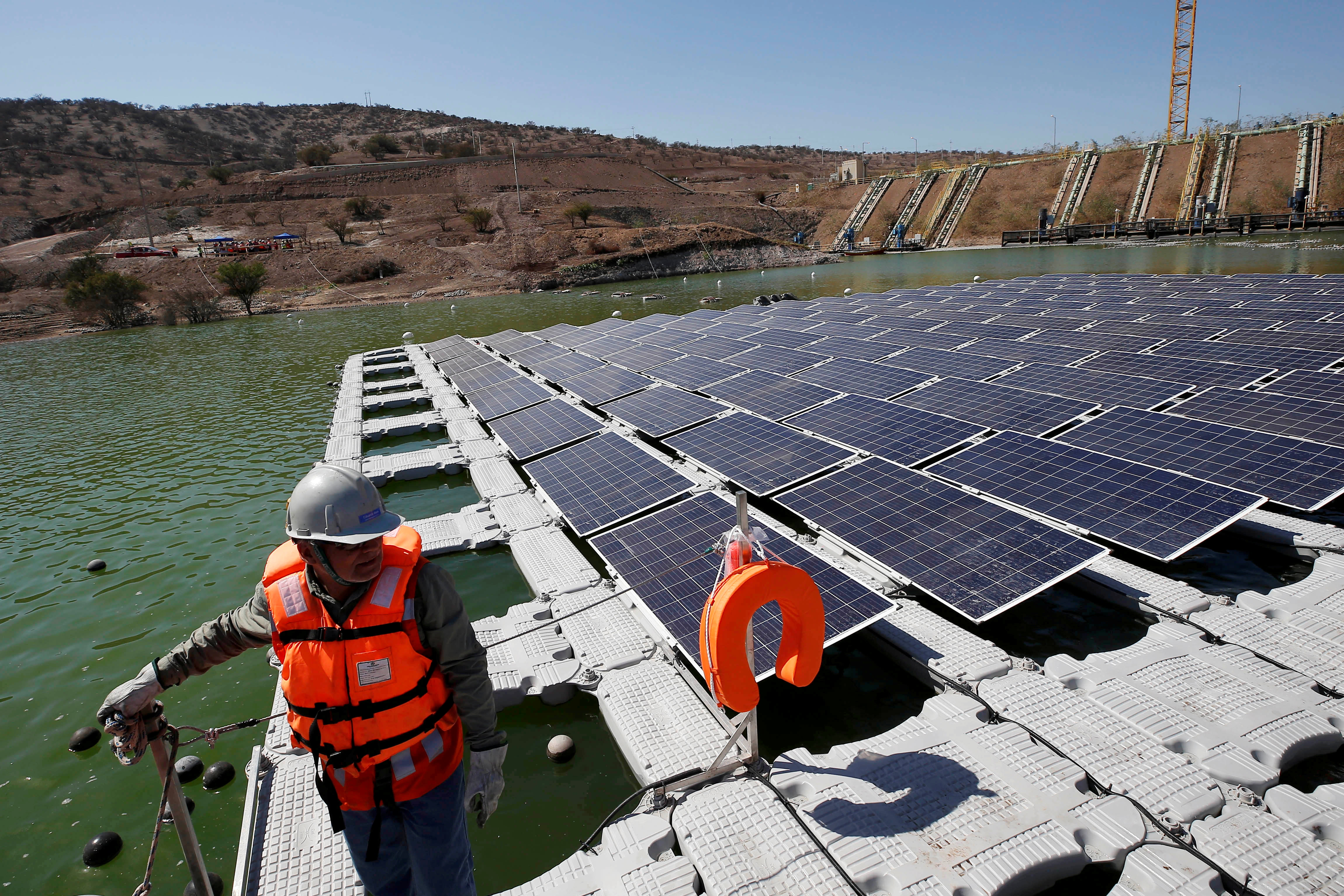 Solar panels are seen during the inauguration of world's first-ever 'island' of solar panels in a tailings pond of the Los Bronces copper mine of Anglo American, on the outskirts of Santiago, Chile March 14, 2019. REUTERS/Rodrigo Garrido