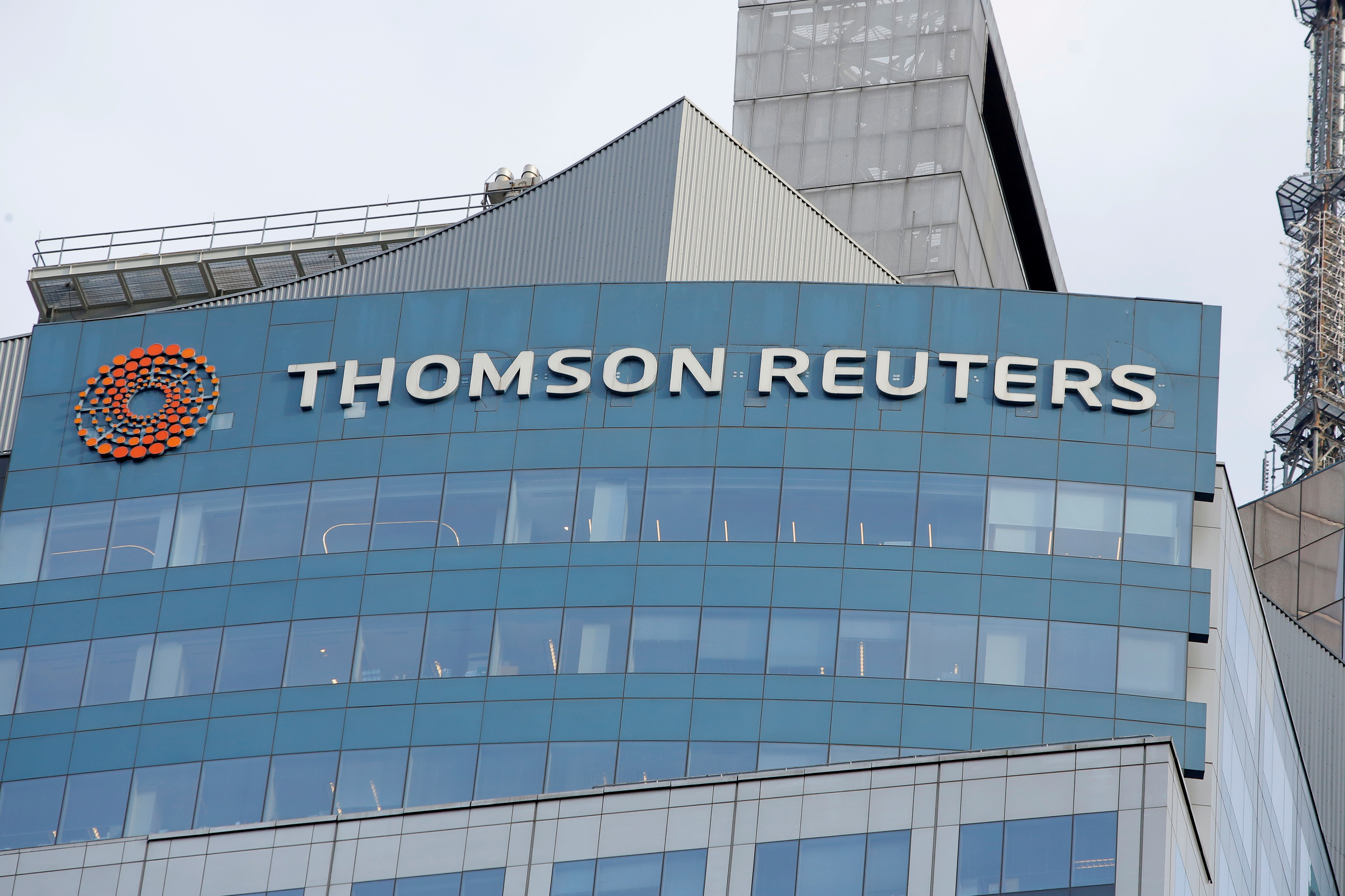 The Thomson Reuters logo is seen on the company building in Times Square, New York, U.S., January 30, 2018. REUTERS/Andrew Kelly//File Photo