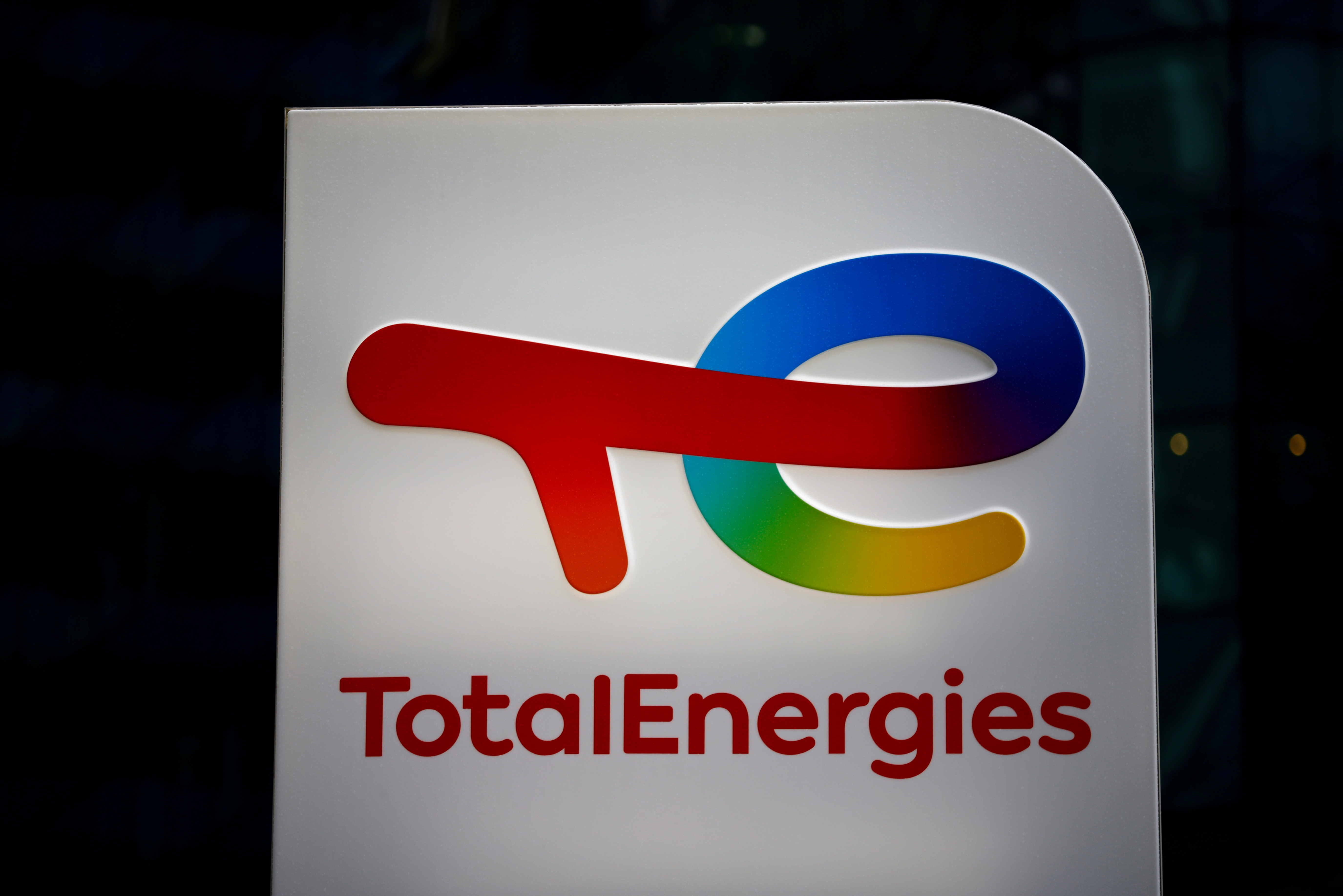 The logo of French oil and gas company TotalEnergies is pictured at an electric car charging station and petrol station at the financial and business district of La Defense in Courbevoie near Paris, France, June 22, 2021. REUTERS/Gonzalo Fuentes/File Photo
