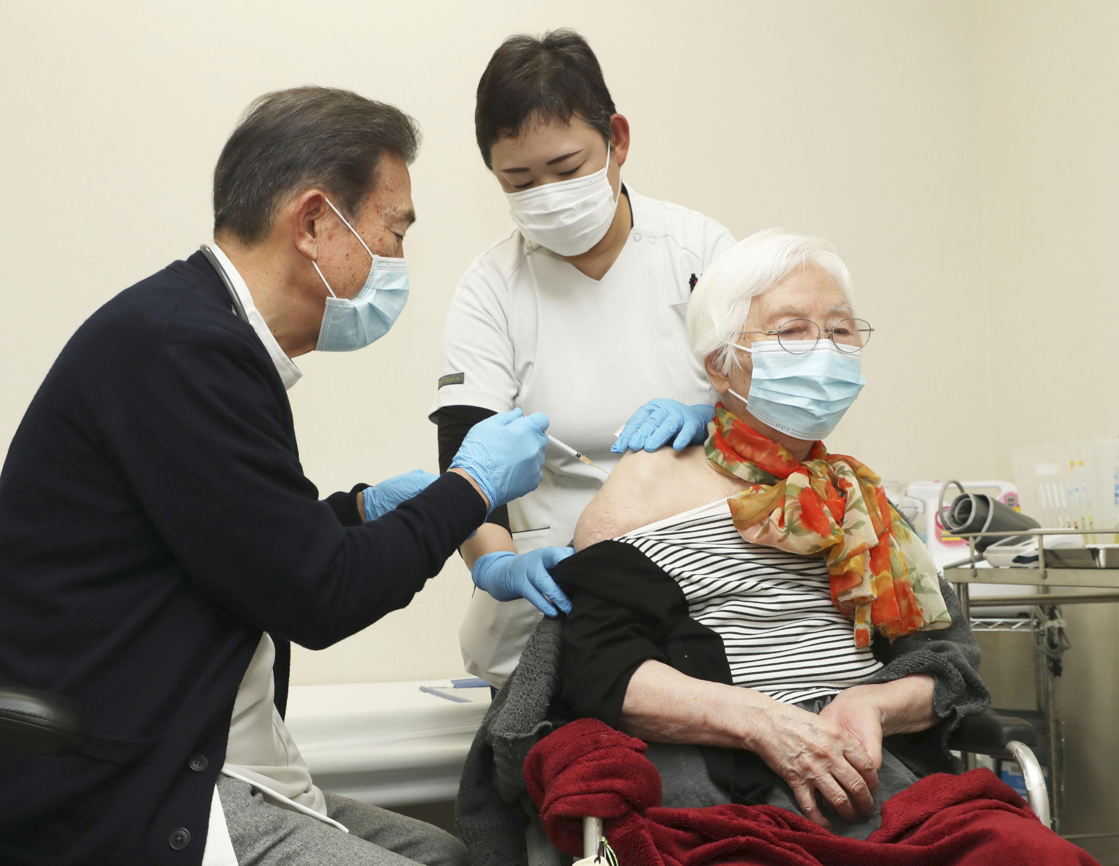 An elderly woman receives a coronavirus disease (COVID-19) vaccine shots at a nursery home in Tsu in Mie Prefecture, central Japan, April 12, 2021, in this photo released by Kyodo. Kyodo/via REUTERS