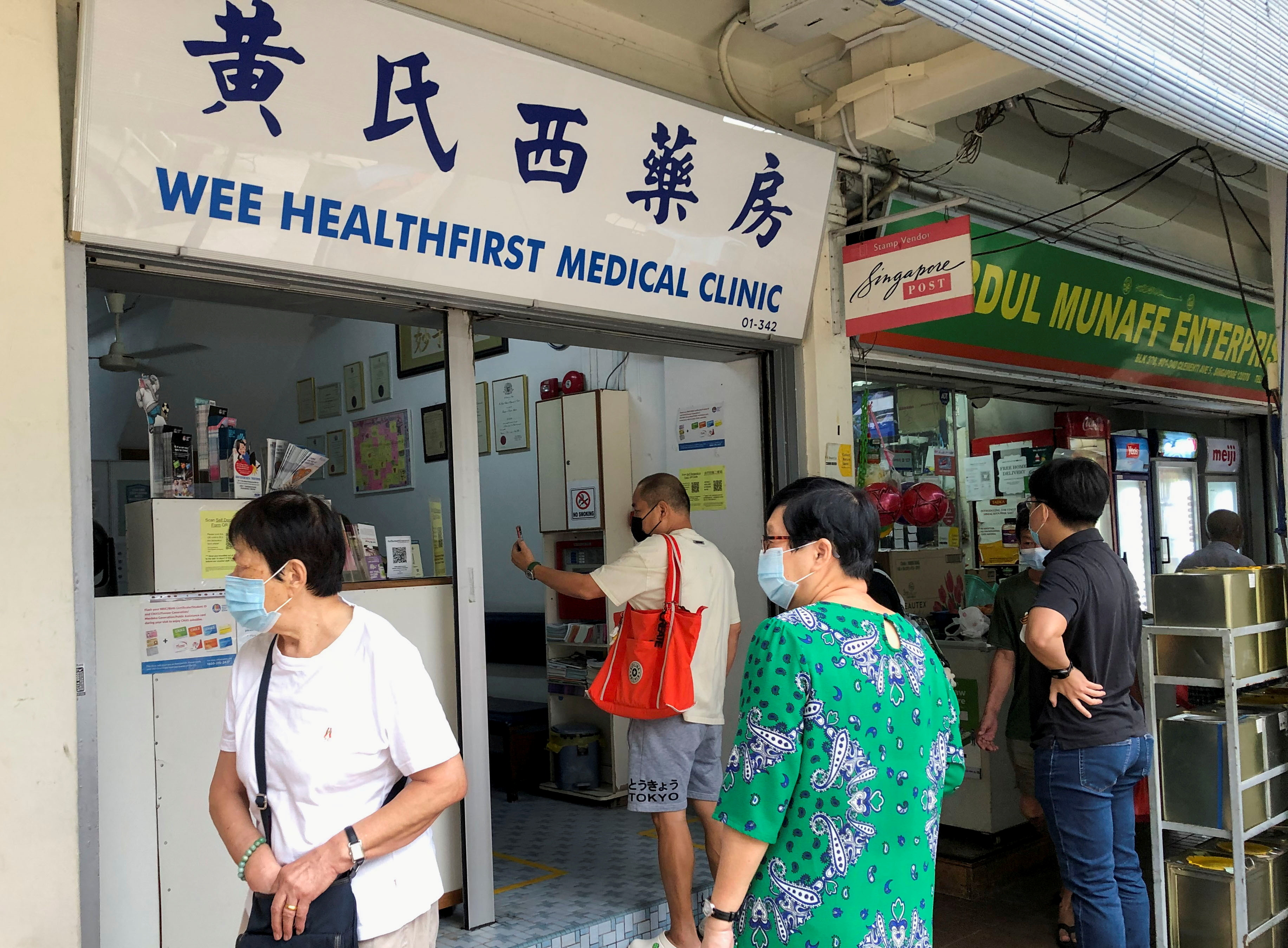 People queue to enquire about Sinovac vaccine at a clinic, during the coronavirus disease (COVID-19) outbreak in Singapore June 18, 2021.  REUTERS/Chen Lin