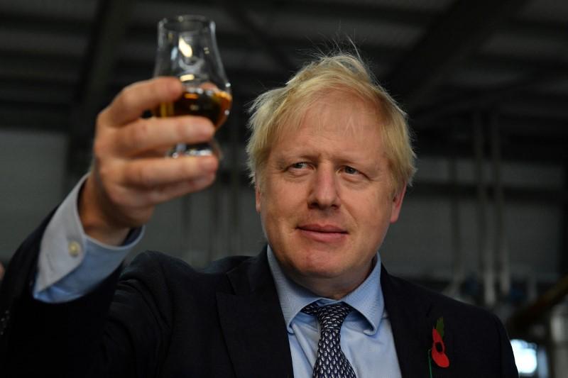 Britain's Prime Minister Boris Johnson tastes whisky during a general election campaign visit to Diageo's Roseisle Distillery near Elgin, Scotland, Britain November 7, 2019. Daniel Leal-Olivas/Pool via REUTERS/File Photo