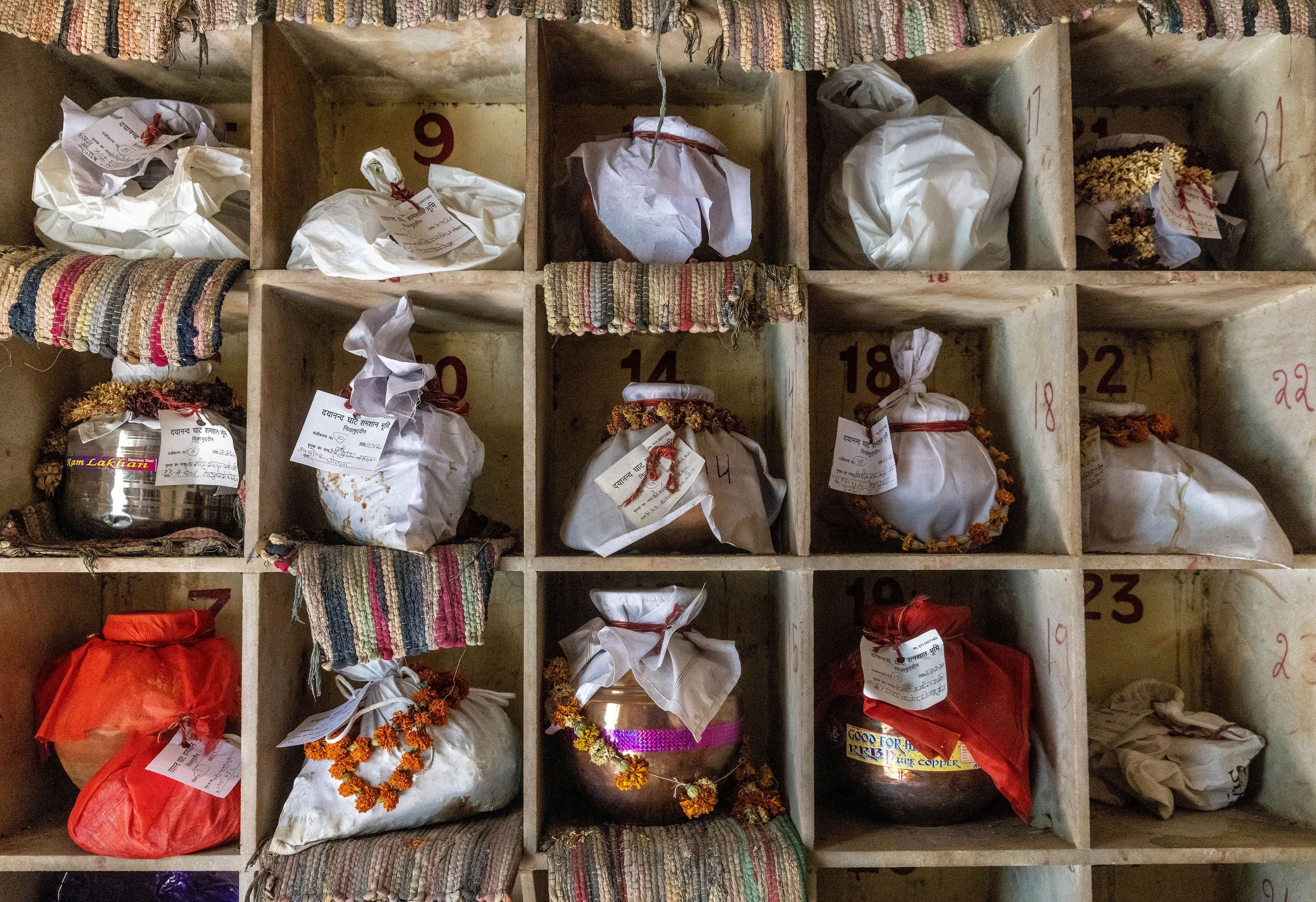 Urns containing ashes after final rites of people including those who died from the coronavirus disease (COVID-19) await immersion due to lockdown, at a crematorium in New Delhi, India, May 6, 2021. REUTERS/Danish Siddiqui/File Photo