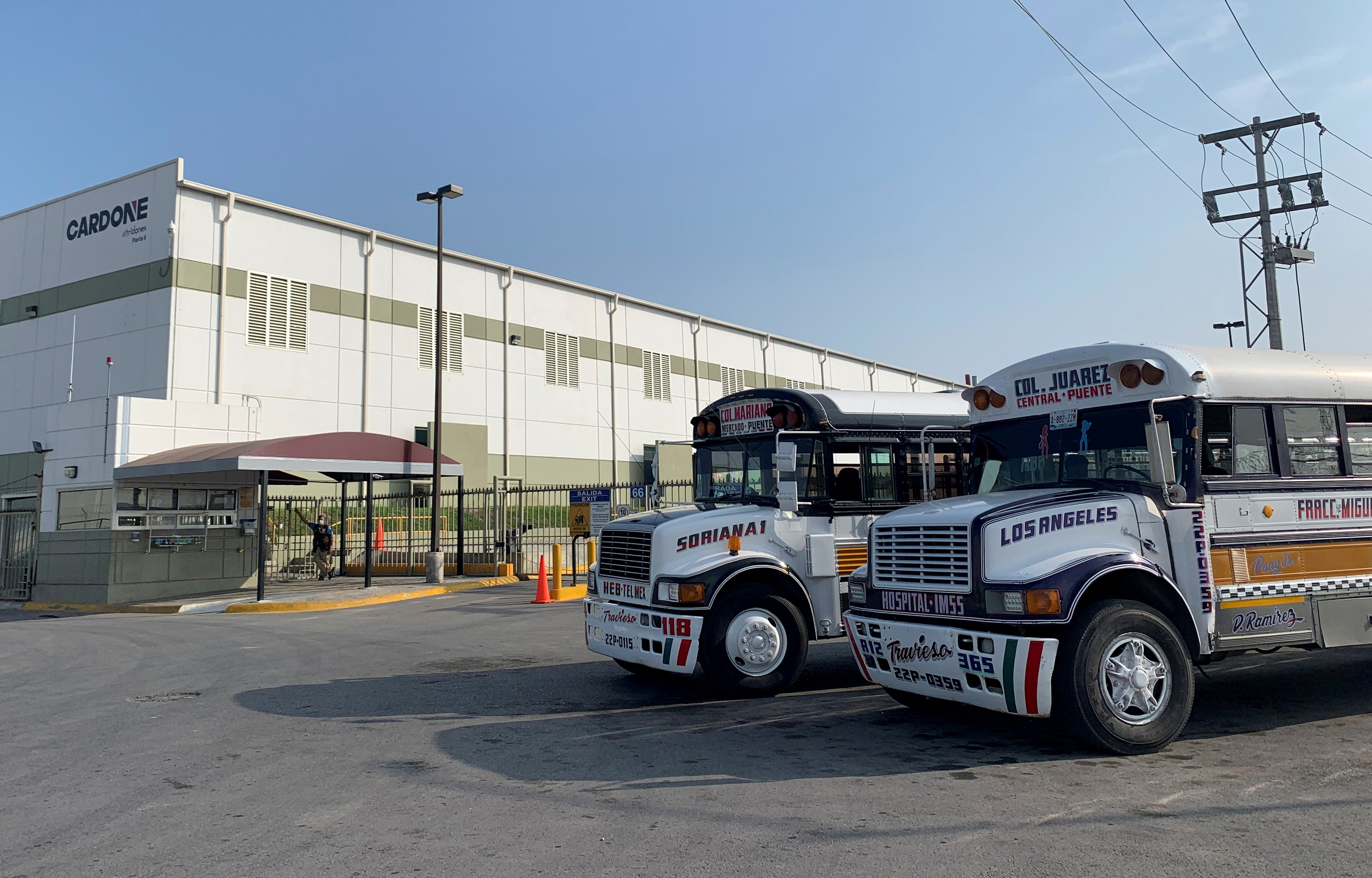 Commuter buses are parked outside the Tridonex auto-parts plant, owned by Philadelphia-based Cardone Industries, in Matamoros, Mexico January 25, 2021. REUTERS/Daina Solomon/File Photo
