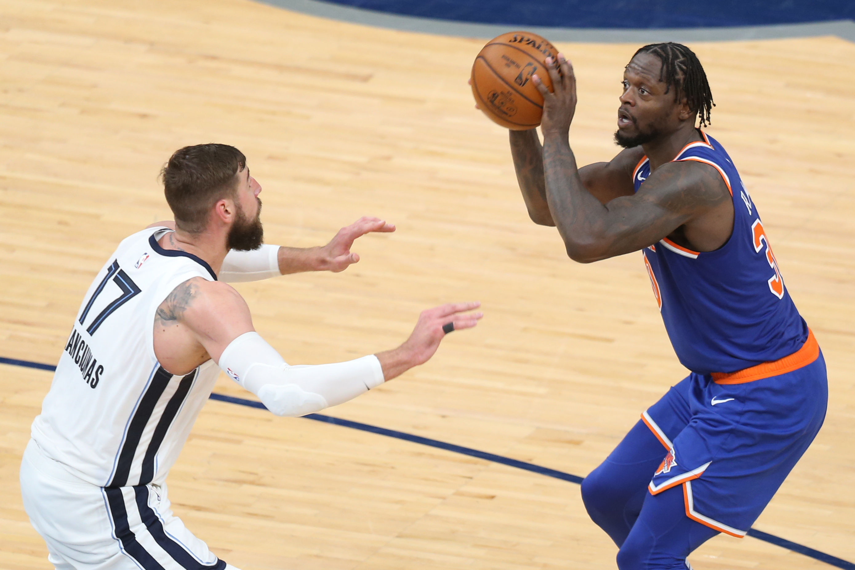 May 3, 2021; Memphis, Tennessee, USA; New York Knicks forward Julius Randle (30) shoots as Memphis Grizzlies center Jonas Valanciunas (17) defends in the fourth quarter at FedExForum. Knicks won 118-104. Mandatory Credit: Nelson Chenault-USA TODAY Sports