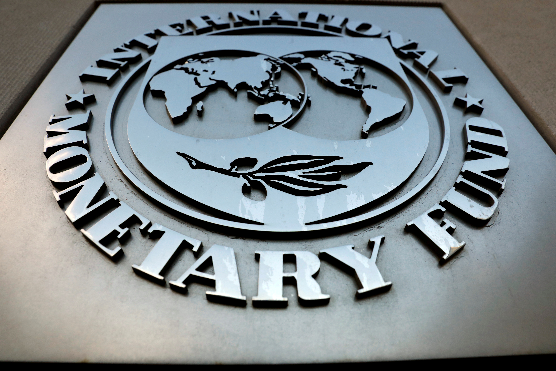 The International Monetary Fund (IMF) logo is seen outside the headquarters building in Washington, U.S., September 4, 2018. REUTERS/Yuri Gripas/File Photo