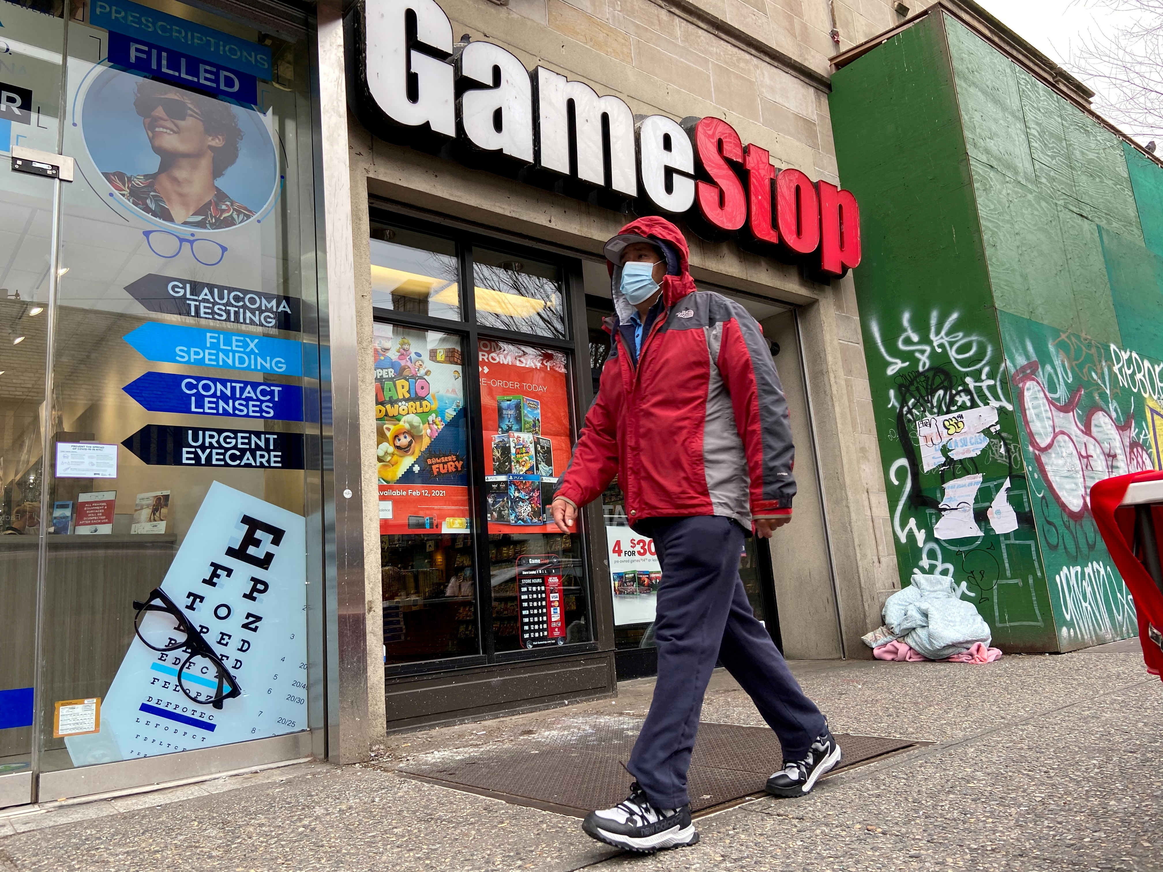 A man walks in front of a GameStop store in the Jackson Heights neighborhood of New York City, New York, U.S. January 27, 2021. Picture taken January 27, 2021. REUTERS/Nick Zieminski/File Photo