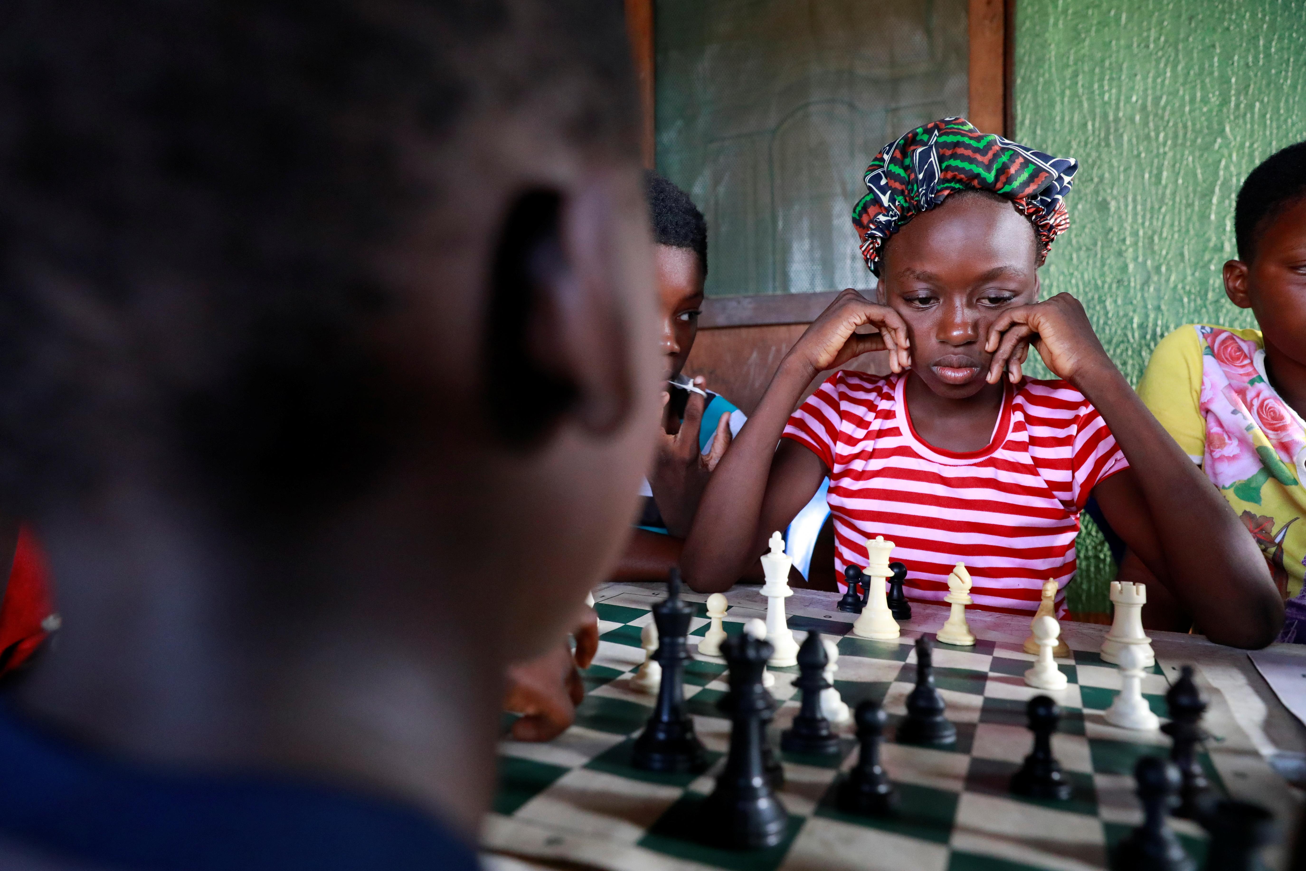 Children play chess at a community palace in Makoko, Lagos, Nigeria May 5, 2021. REUTERS/Temilade Adelaja