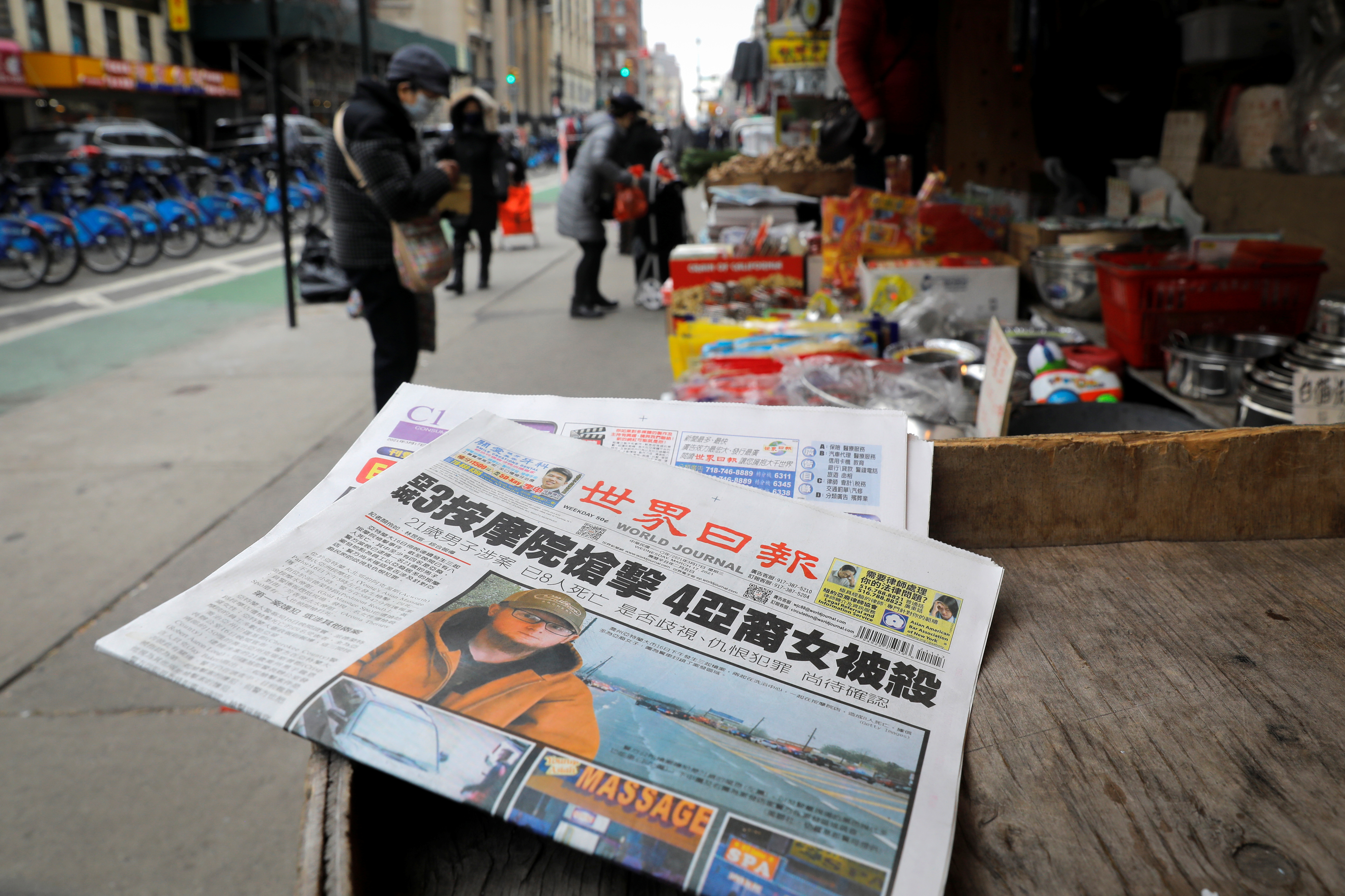 A newspaper in Chinese language sits outside a shop with headlines about the deadly shootings at three spas in Georgia, in the Chinatown section of Manhattan in New York City, New York, U.S., March 17, 2021. REUTERS/Mike Segar