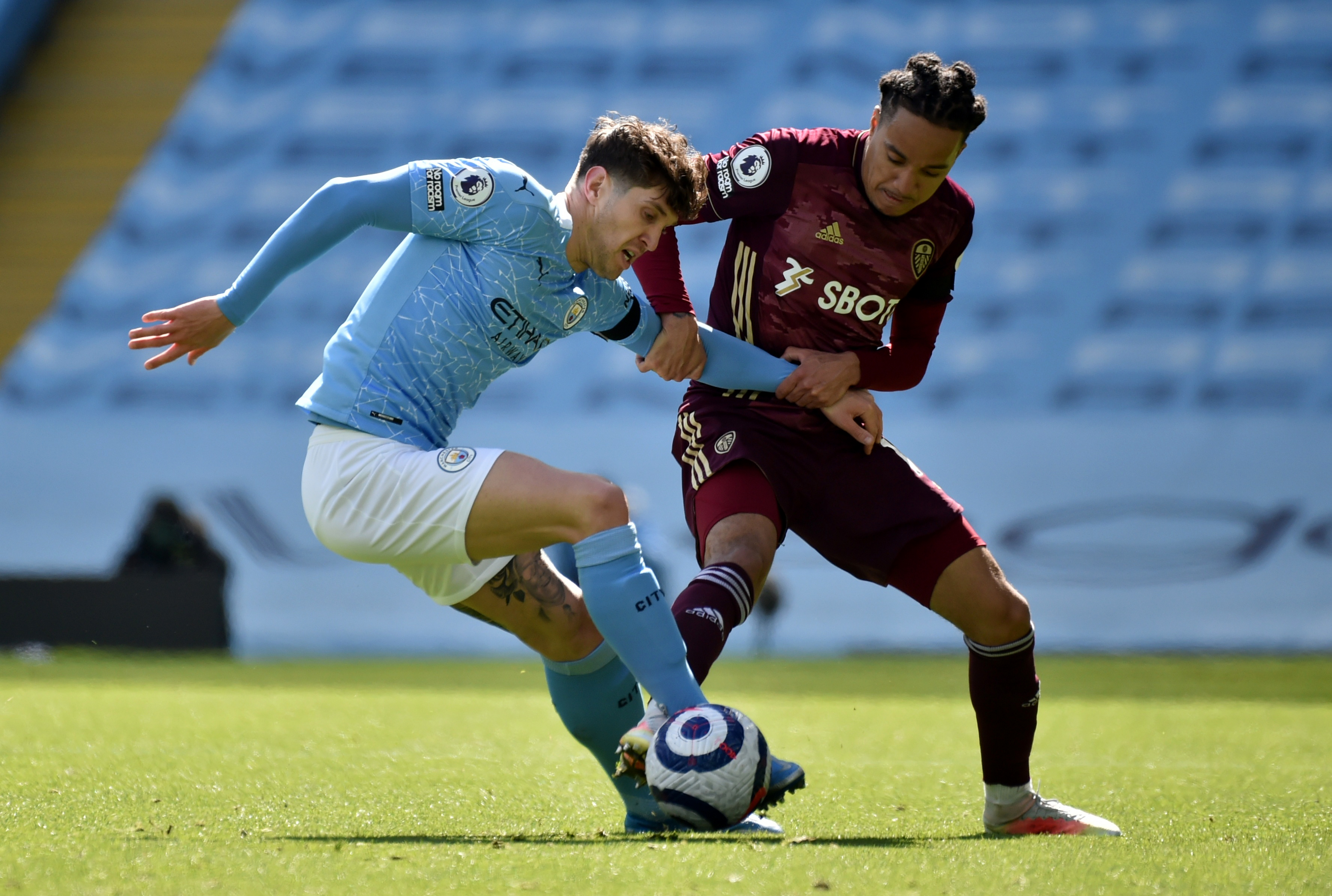 Soccer Football - Premier League - Manchester City v Leeds United - Etihad Stadium, Manchester, Britain - April 10, 2021 Manchester City's John Stones in action with Leeds United's Helder Costa Pool via REUTERS/Rui Vieira