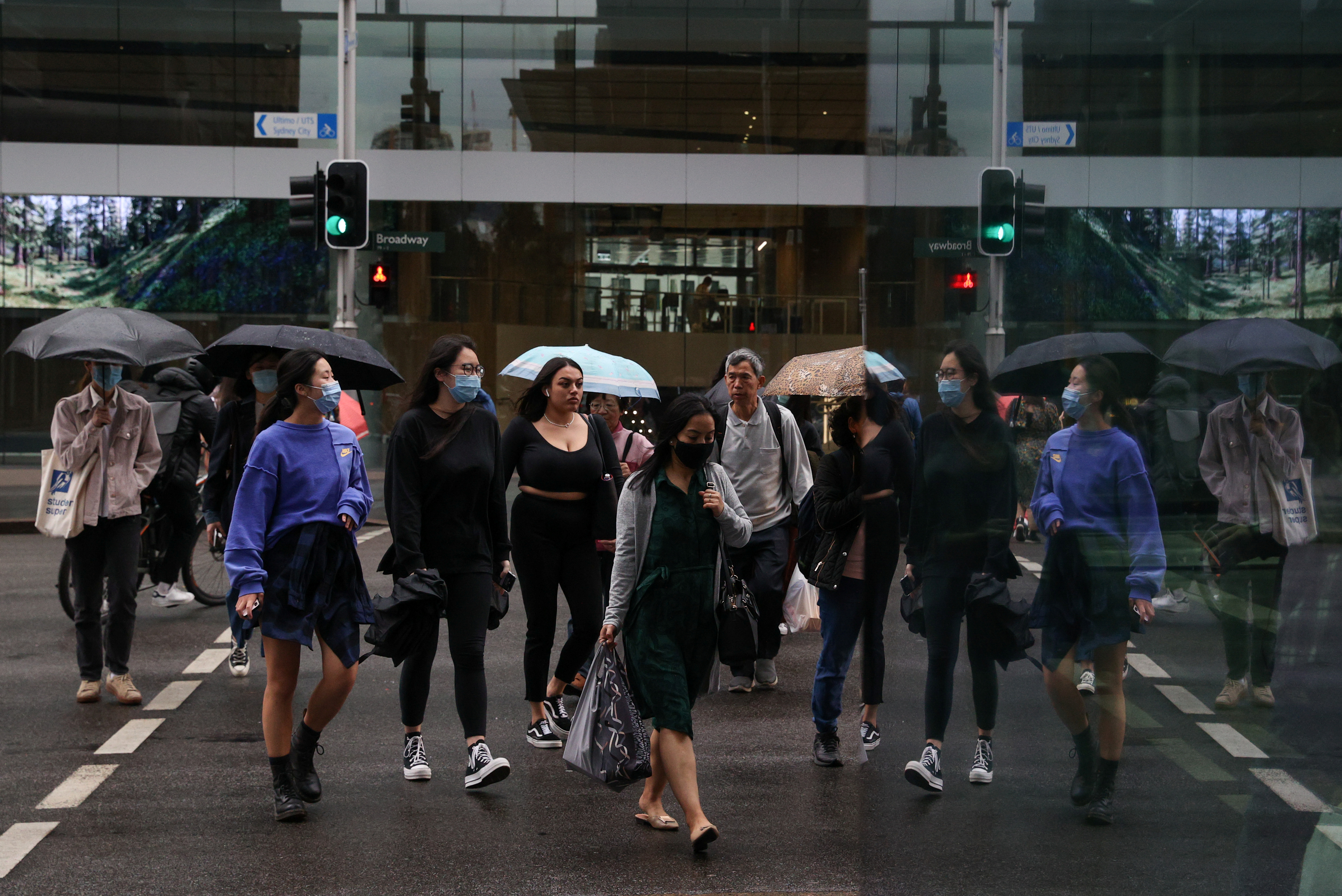 People walk through the city centre as the state of New South Wales continues to report relatively low numbers for new daily cases of the coronavirus disease (COVID-19), in Sydney, Australia, September 4, 2020. REUTERS/Loren Elliott