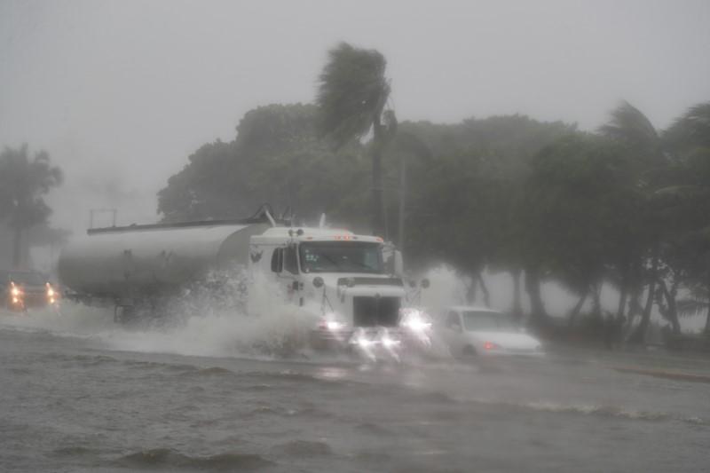 Überflutete Straßen in der Dominikanischen Republik, 11.August 2021   Bildquelle: https://t1p.de/89cw © REUTERS/Ricardo Rojas   Bilder sind in der Regel urheberrechtlich geschützt
