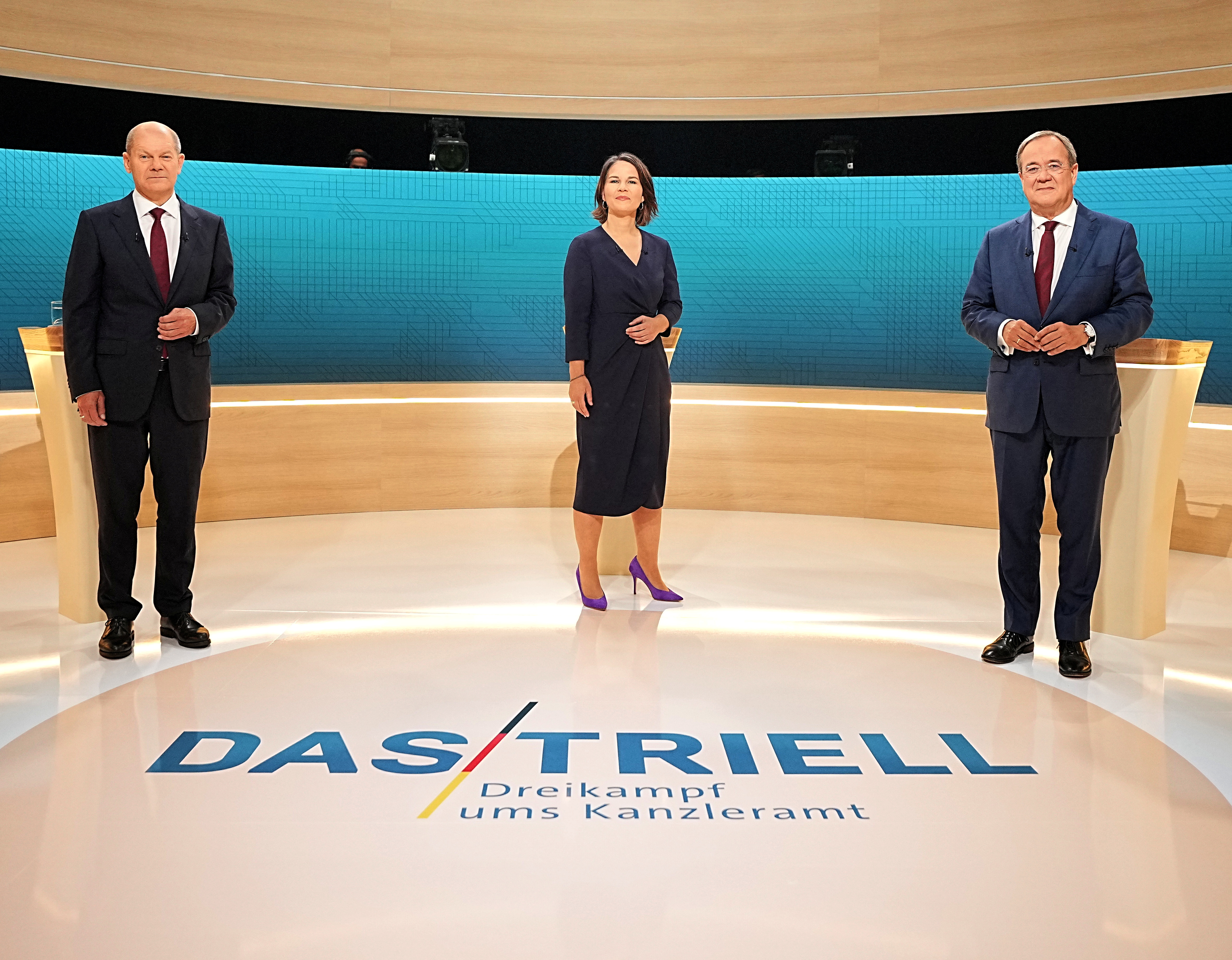 Chairwoman of Buendnis 90/Die Gruenen Annalena Baerbock, Prime Minister of North Rhine-Westphalia (NRW) and leader of the Christian Democratic Union (CDU) Armin Laschet and German Finance Minister and Social Democratic Party candidate Olaf Scholz are pictured before a televised debate of the candidates to succeed Angela Merkel as German chancellor in Berlin,?Germany, September 12, 2021. Michael?Kappeler/Pool via REUTERS