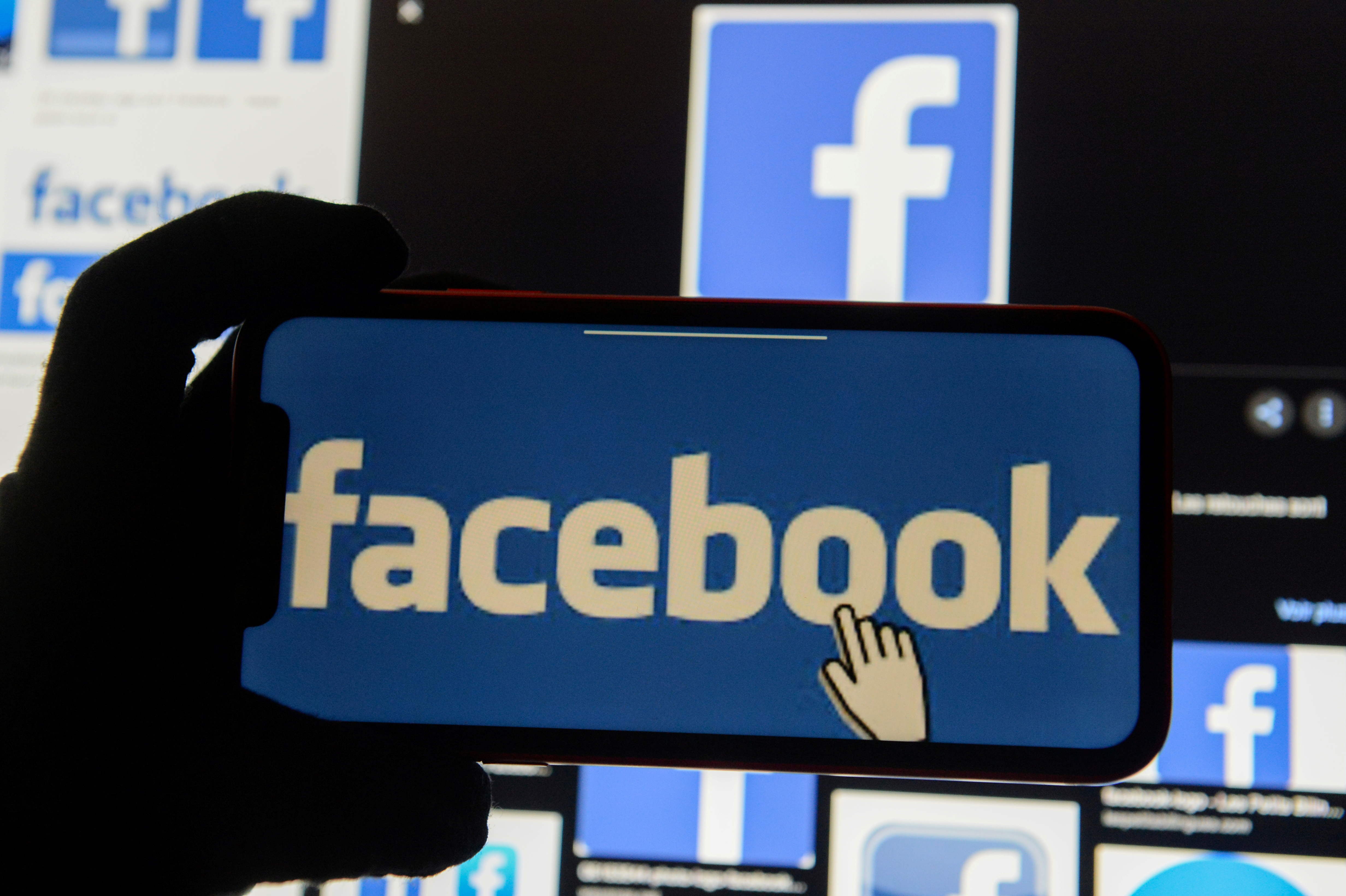 The Facebook logo is displayed on a mobile phone in this picture illustration taken December 2, 2019. REUTERS/Johanna Geron/Illustration/File Photo