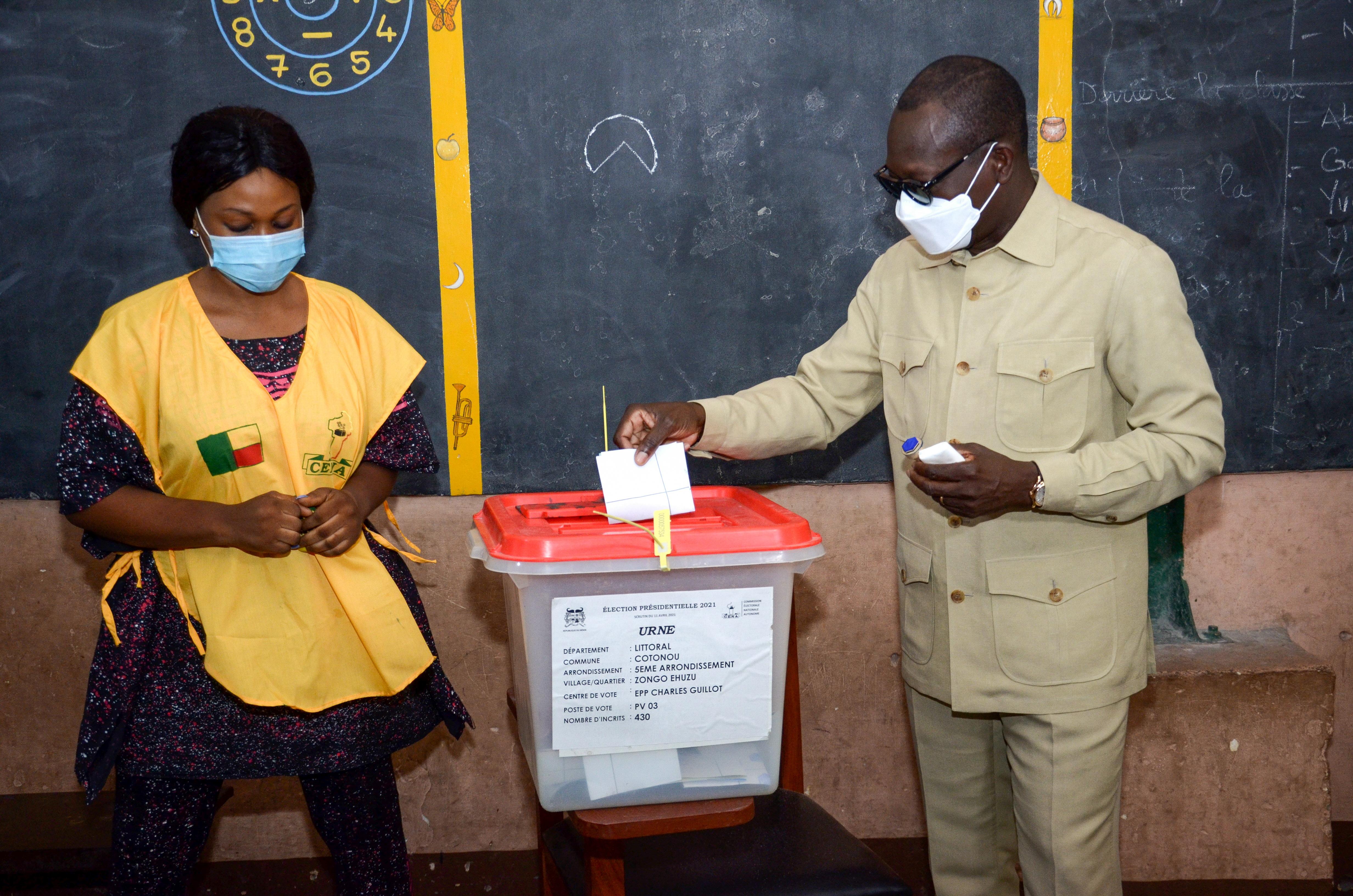 Benin's president Patrice Talon casts his ballot at a polling station in Cotonou, Benin April 11, 2021. REUTERS/Charle Placide Tossou