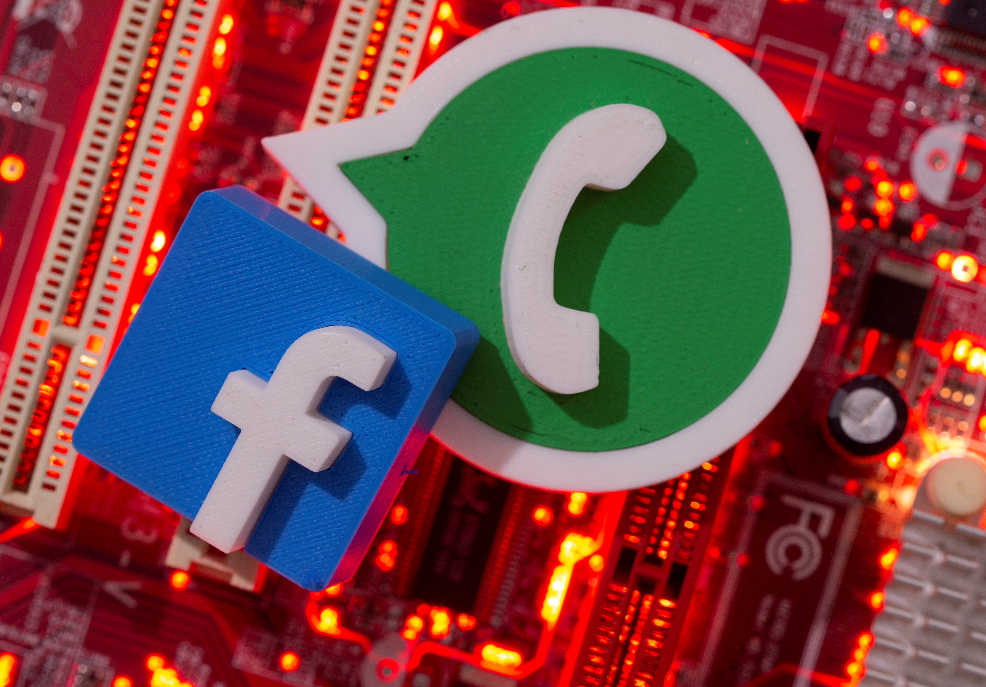 3D printed WhatsApp and Facebook logos are placed on a computer motherboard in this illustration taken January 21, 2021. REUTERS/Dado Ruvic/Illustration/File Photo