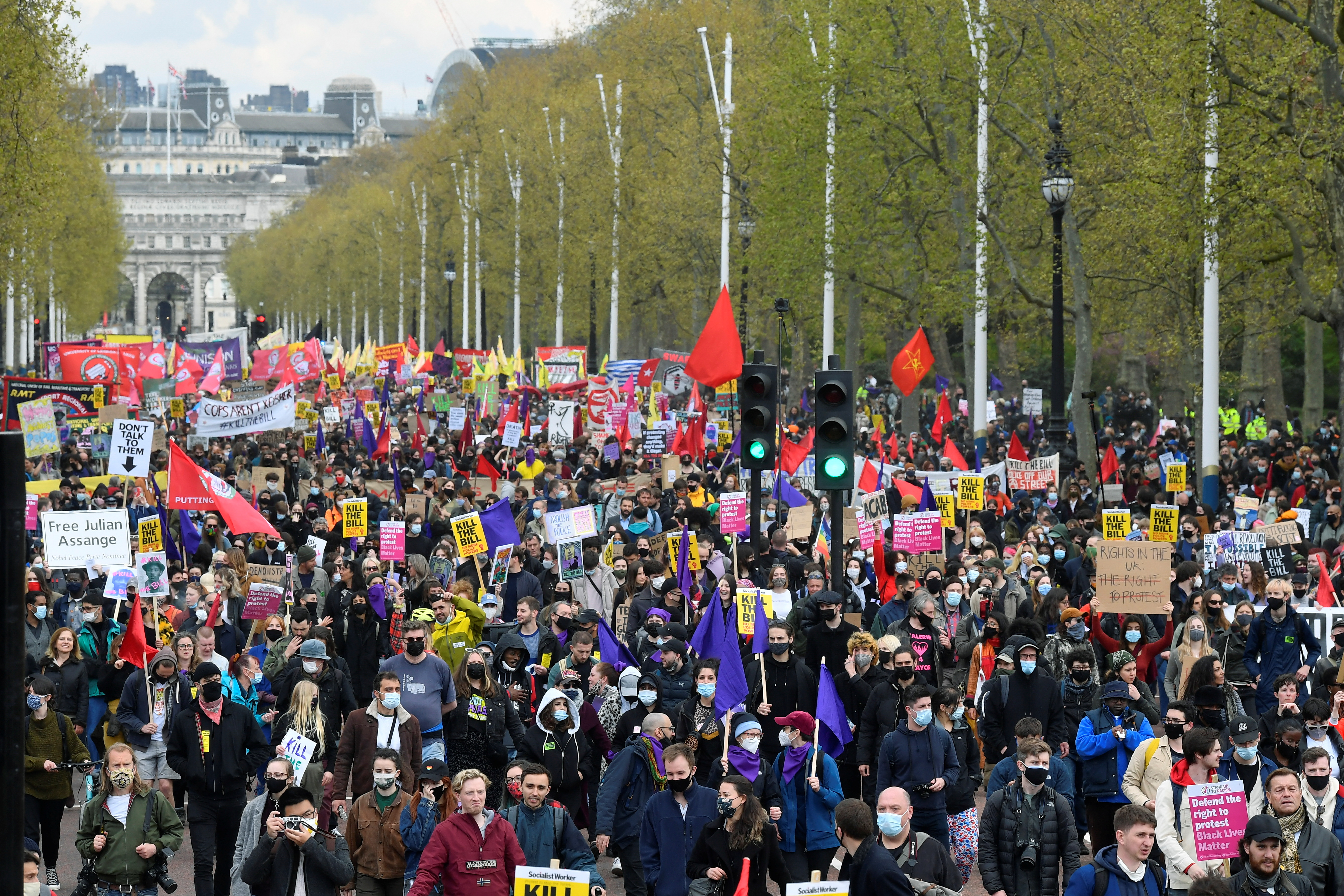 """Demonstrators march during a """"Kill the Bill"""" protest  in London, Britain, May 1, 2021. REUTERS/Toby Melville"""