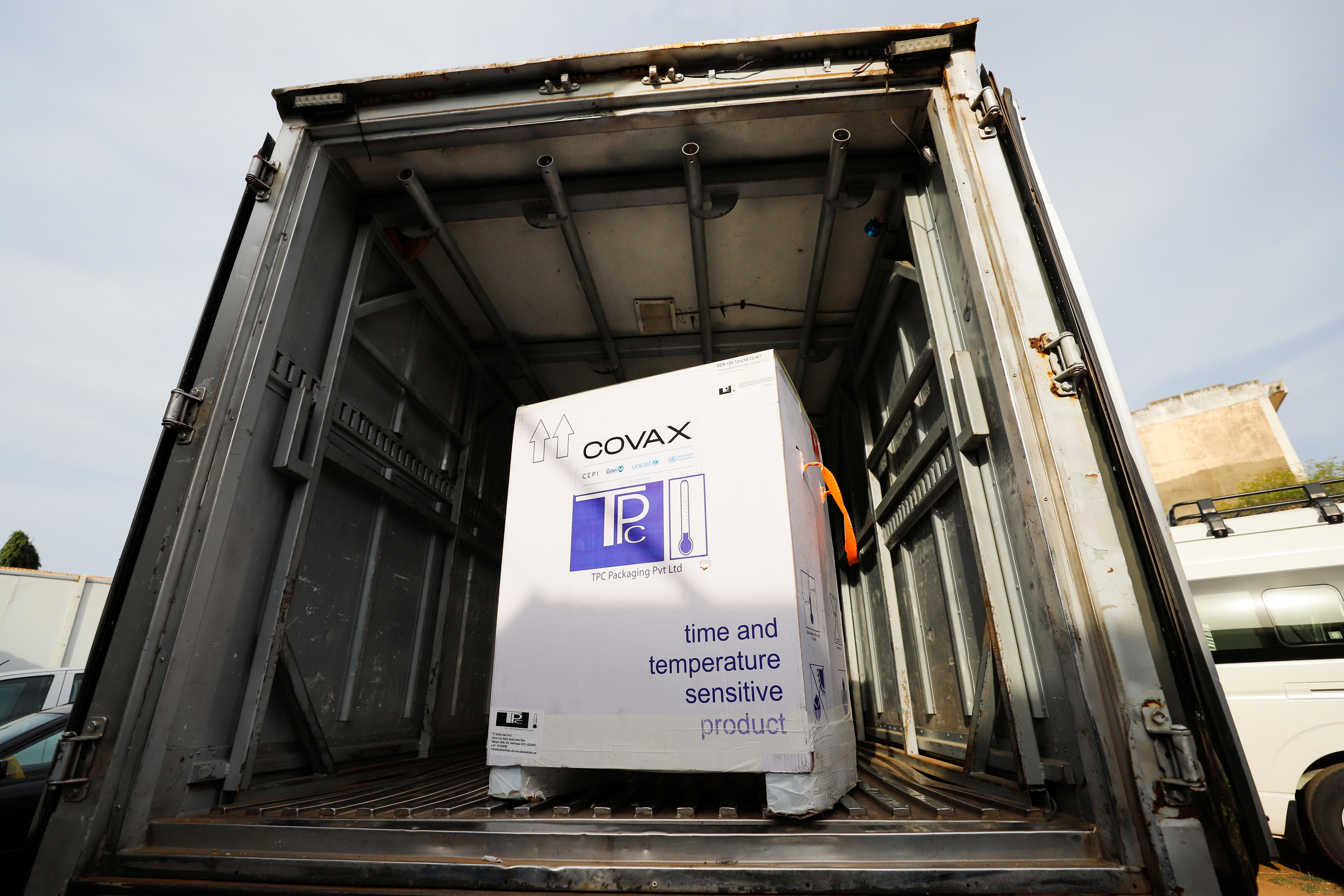 A box of Oxford/AstraZeneca coronavirus disease (COVID-19) vaccines, redeployed from the Democratic Republic of Congo, is seen loaded into a refrigerated delivery truck in Accra, Ghana May 7, 2021. REUTERS/Francis Kokoroko
