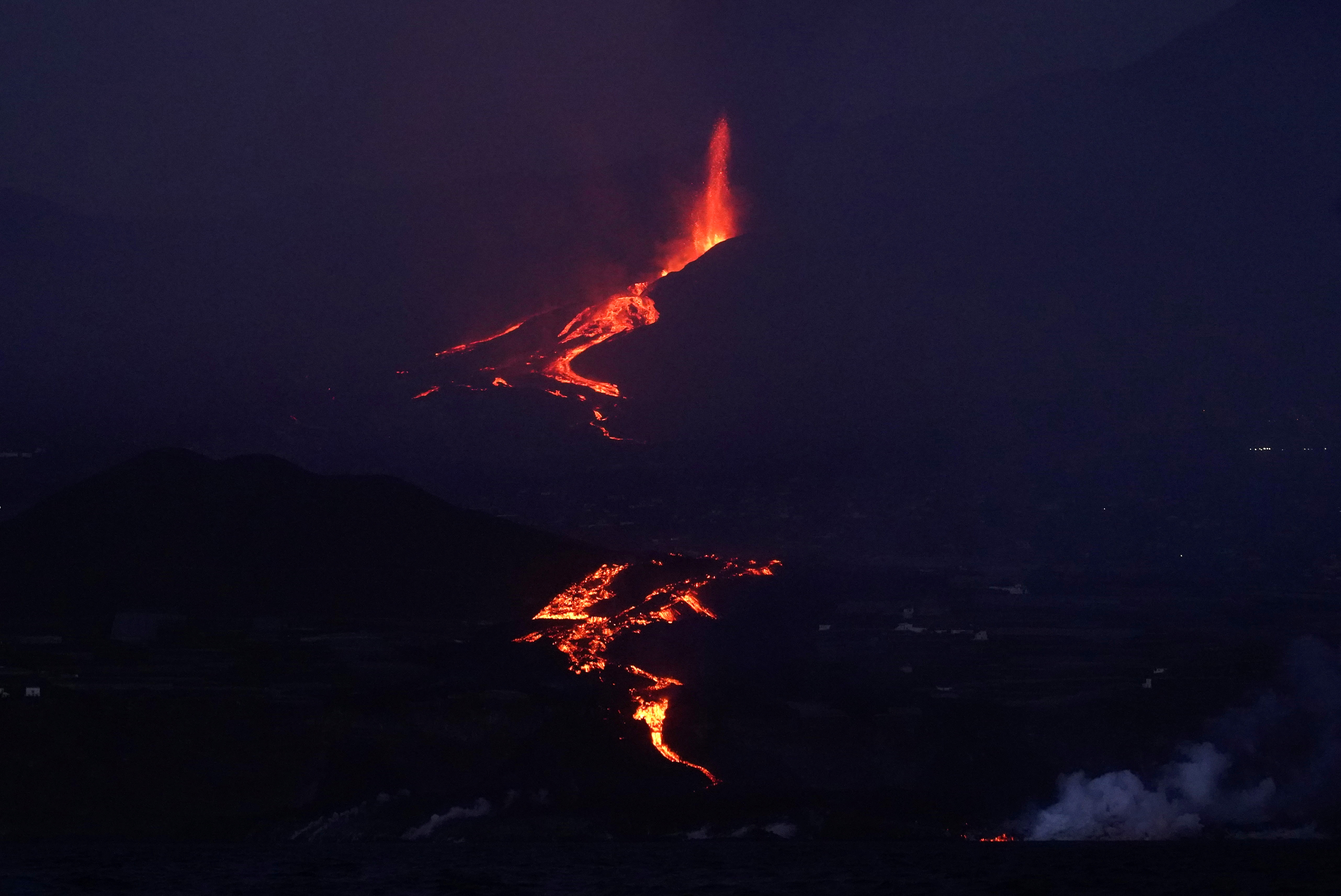 The Cumbre Vieja volcano continues to erupt on the Canary Island of La Palma, as seeen from the sea, Spain, October 3, 2021. REUTERS/Juan Medina