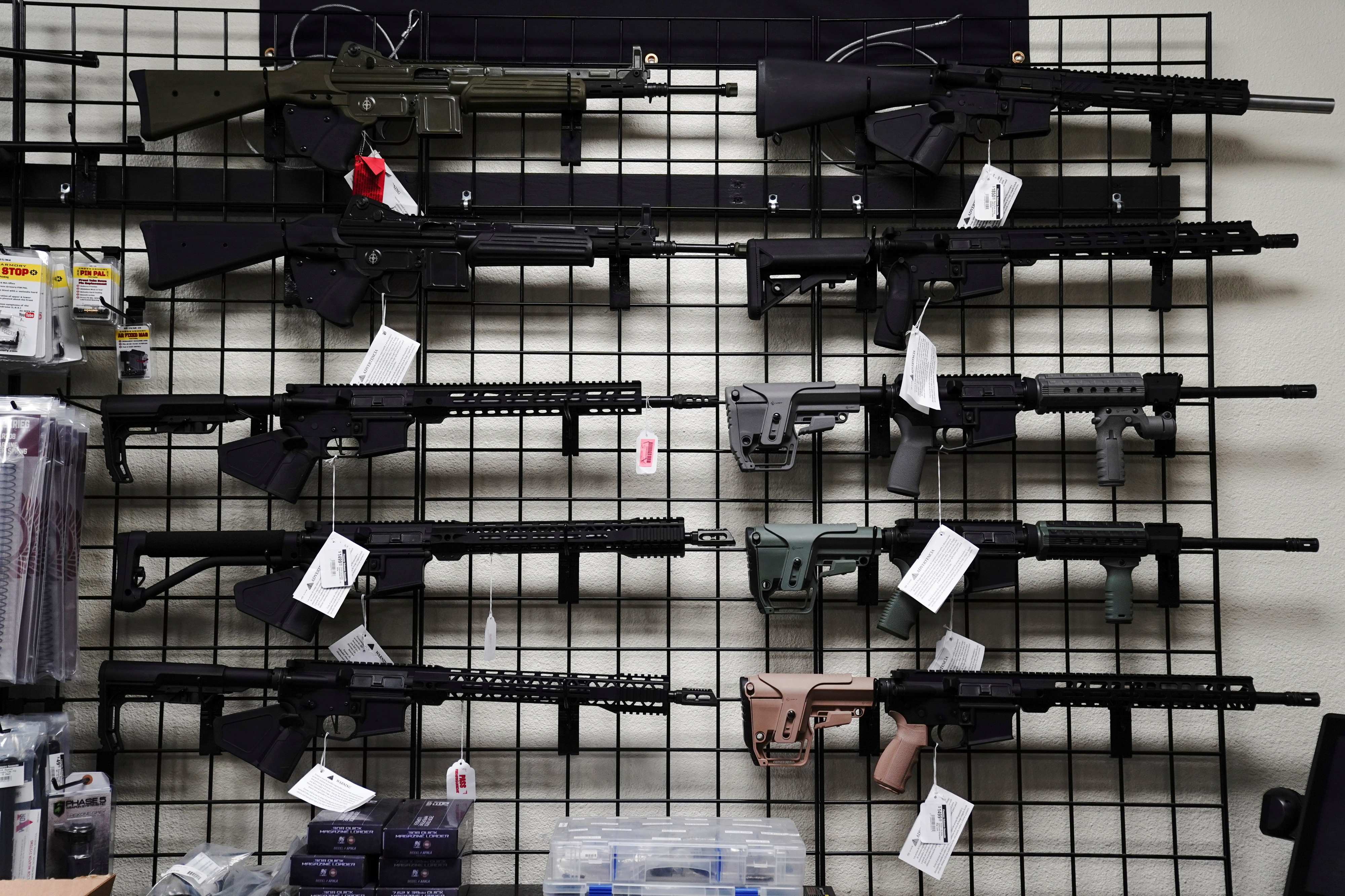 AR-15 style rifles are displayed for sale at Firearms Unknown, a gun store in Oceanside, California, U.S., April 12, 2021. REUTERS/Bing Guan/File Photo