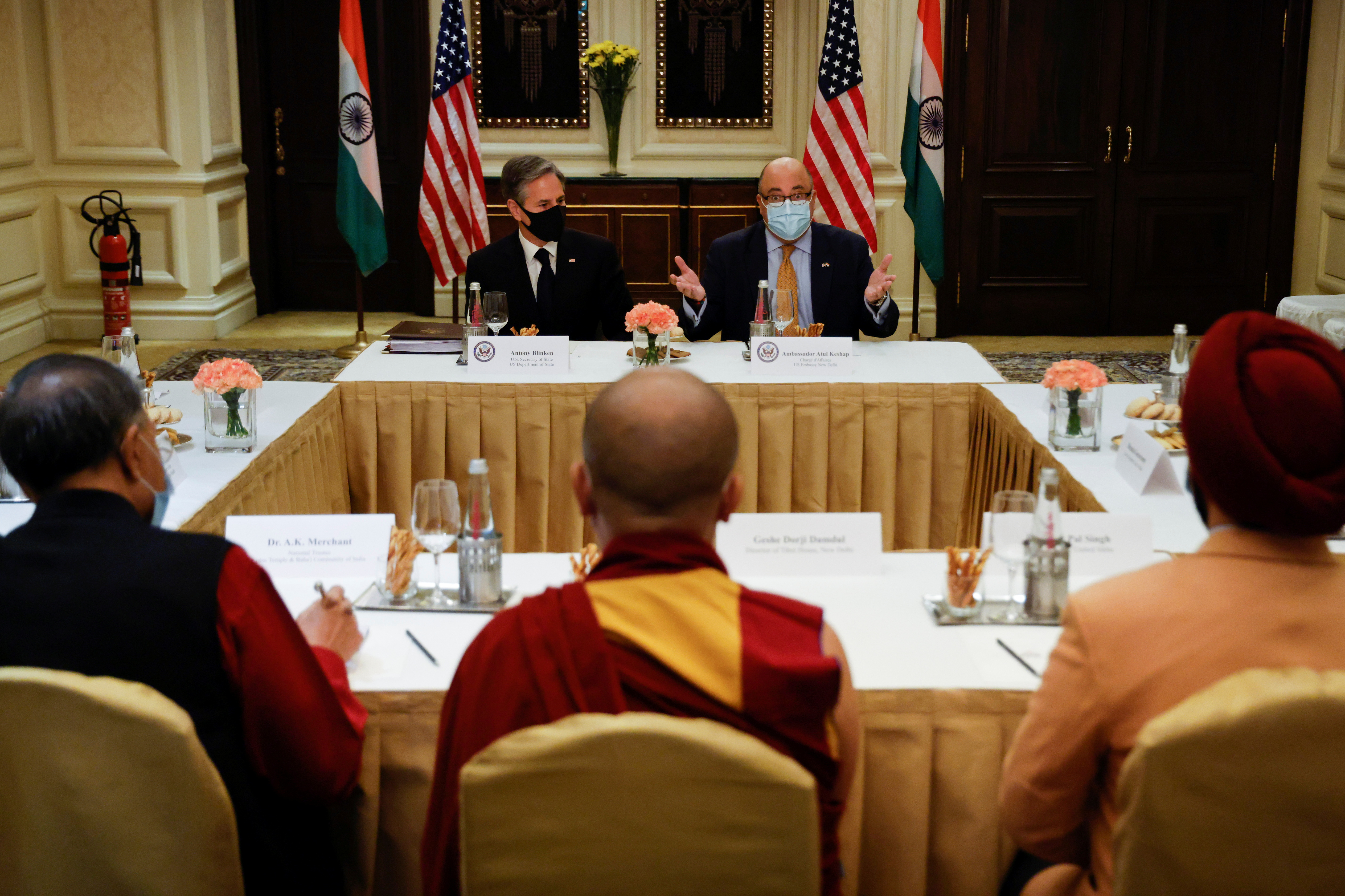 U.S. Secretary of State Antony Blinken and U.S. Ambassador to India Atul Keshap deliver remarks to civil society organization representatives in a meeting room at the Leela Palace Hotel in New Delhi, India, July 28, 2021. REUTERS/Jonathan Ernst
