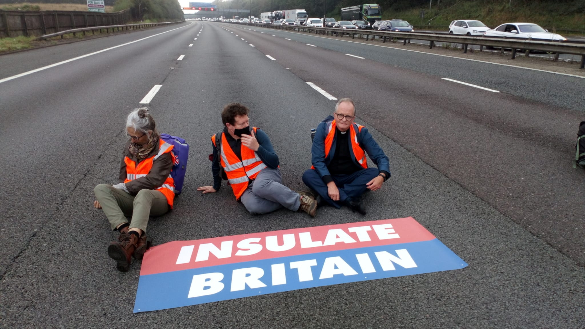 Members of Insulate Britain protest on M25 Motorway, Britain September 15, 2021. Insulate Britain/Handout via REUTERS