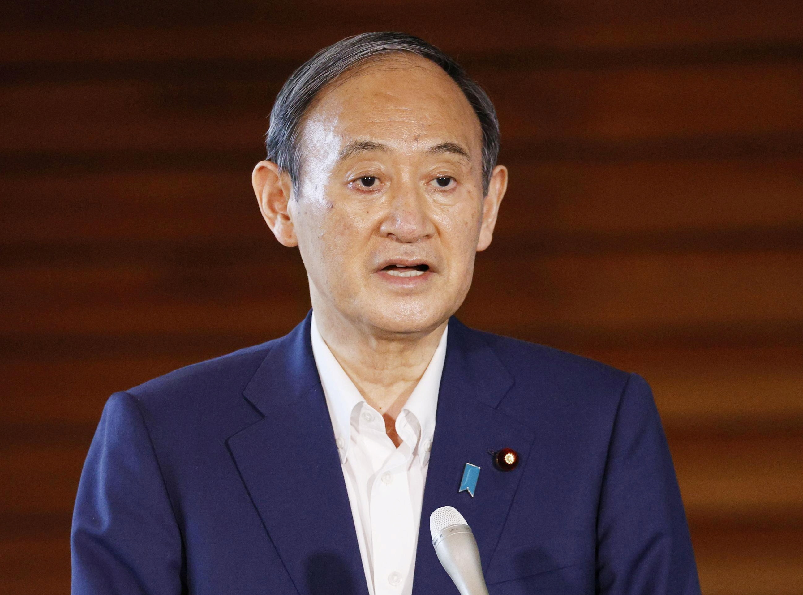 Japan's Prime Minister Yoshihide Suga speaks to media after he annouced to pull out of a party leadership race at his official residence in Tokyo, Japan, September 3, 2021. Kyodo/via REUTERS