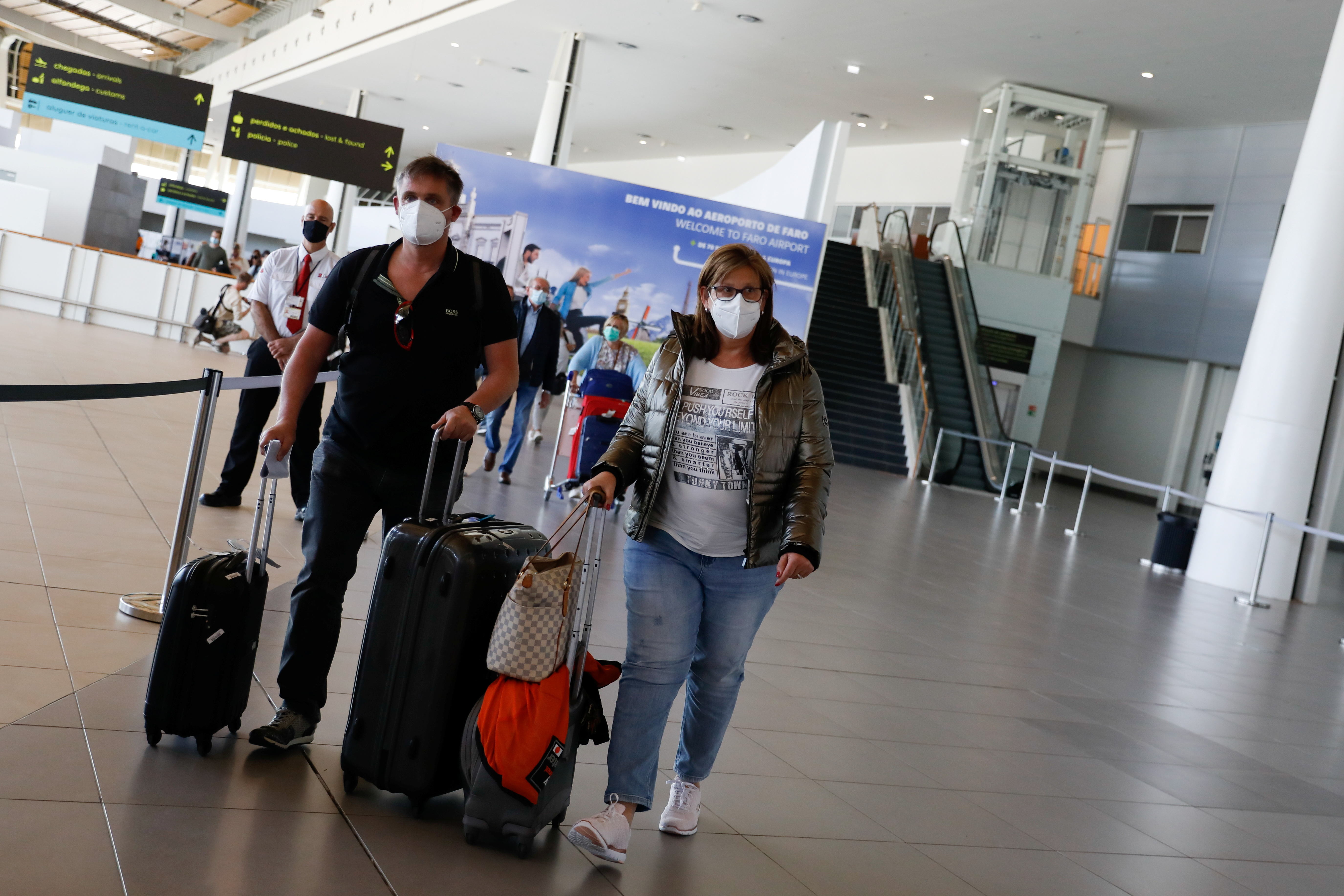 People arrive at Faro Airport from Manchester on the first day that Britons are allowed to enter Portugal without needing to quarantine, as coronavirus disease (COVID-19) restrictions continue to ease, in Faro, Portugal, May 17, 2021. REUTERS/Pedro Nunes