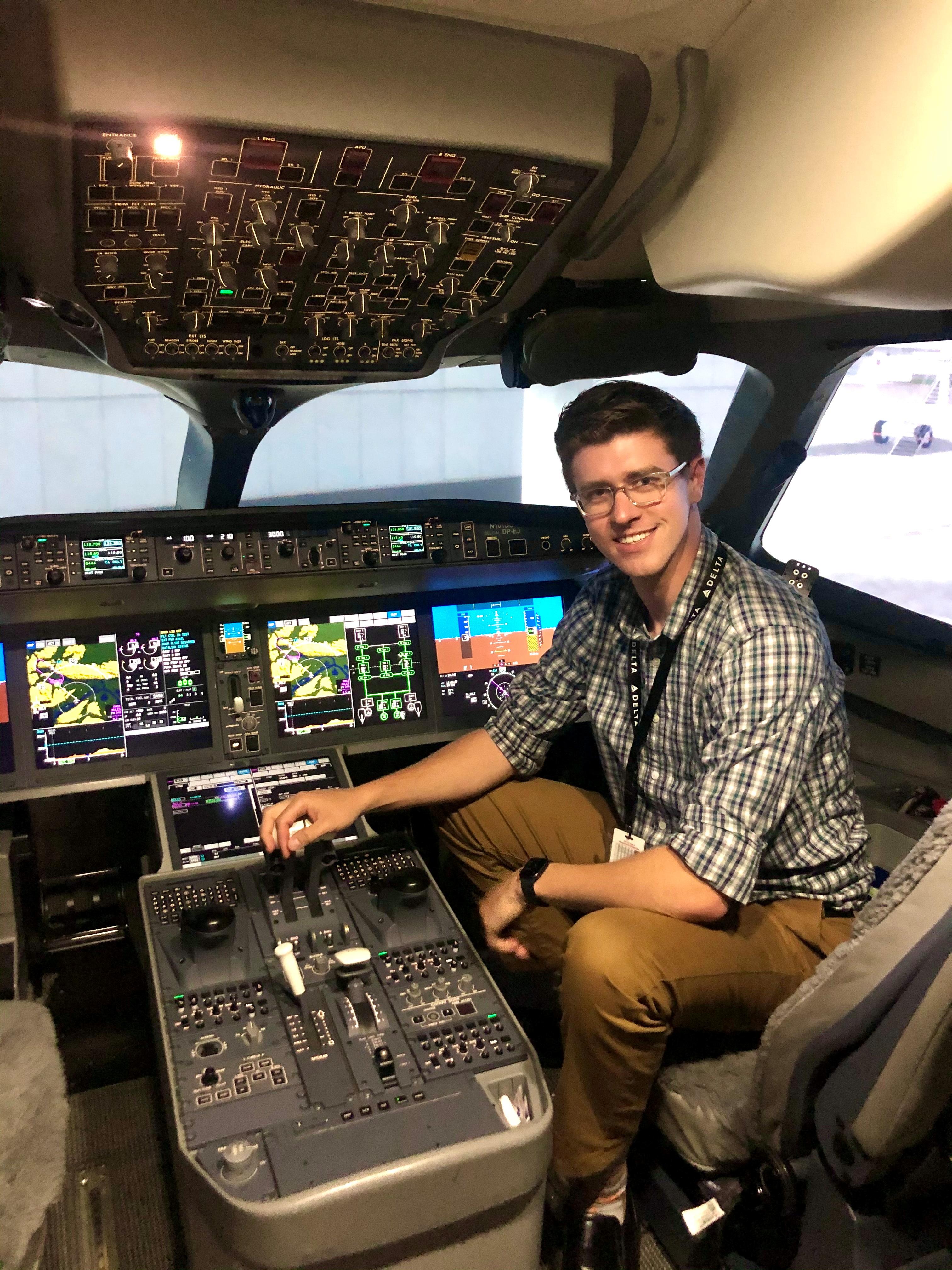 Delta Air Lines pilot Ben Wallander sits in an Airbus A220 simulator in Atlanta, Georgia, U.S., May 30, 2020. Picture taken May 30, 2020. Ben Wallander/Handout via REUTERS